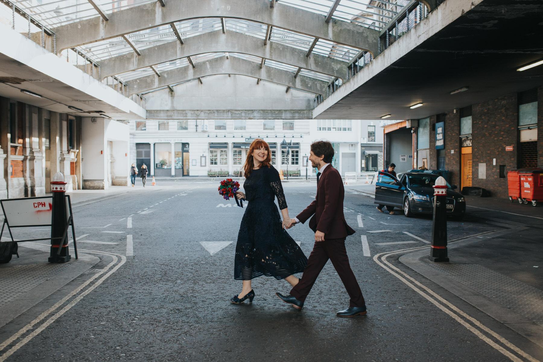 129 Smithfields wedding bride groom walking.jpg
