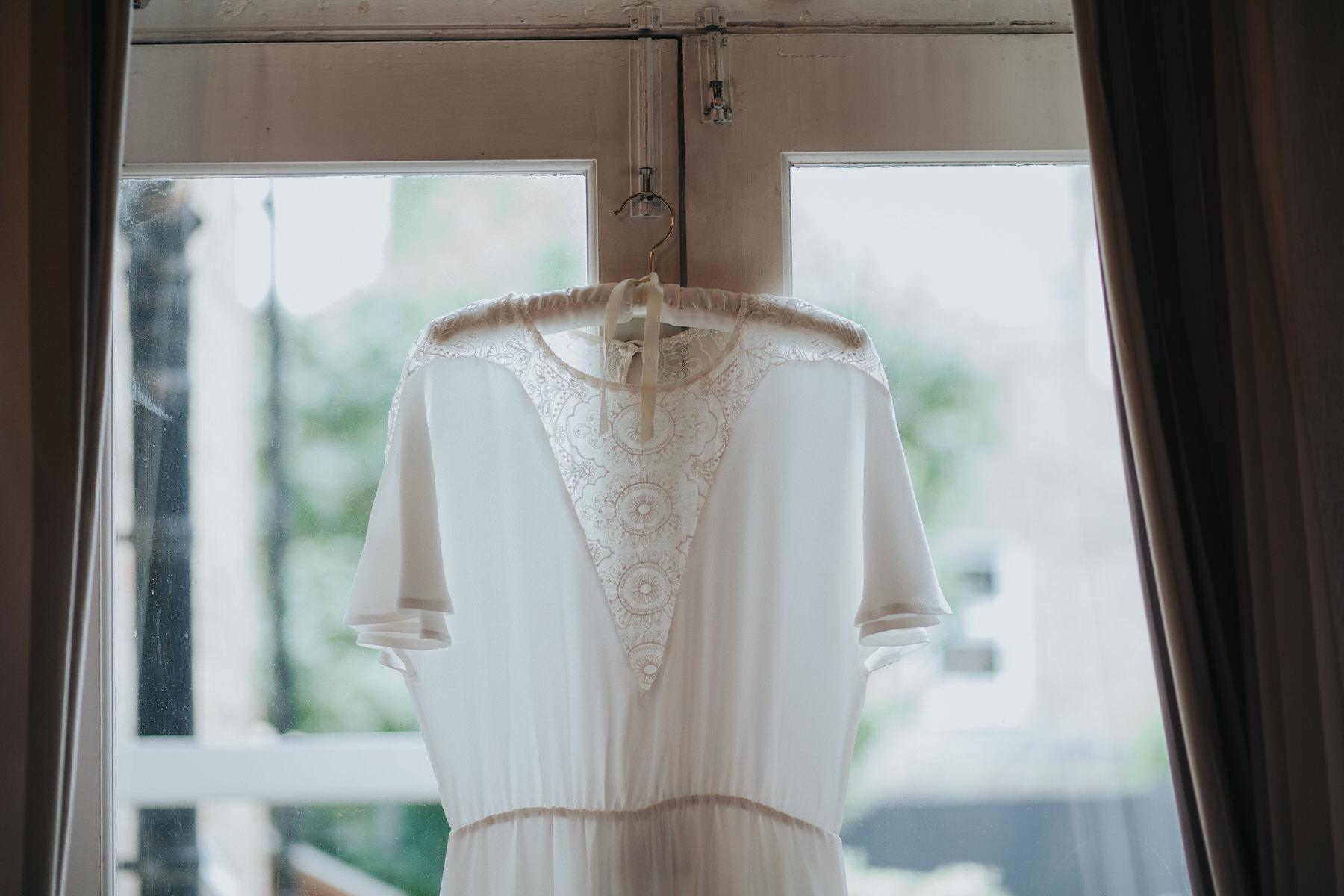 3-bride getting ready Minna wedding dress.jpg