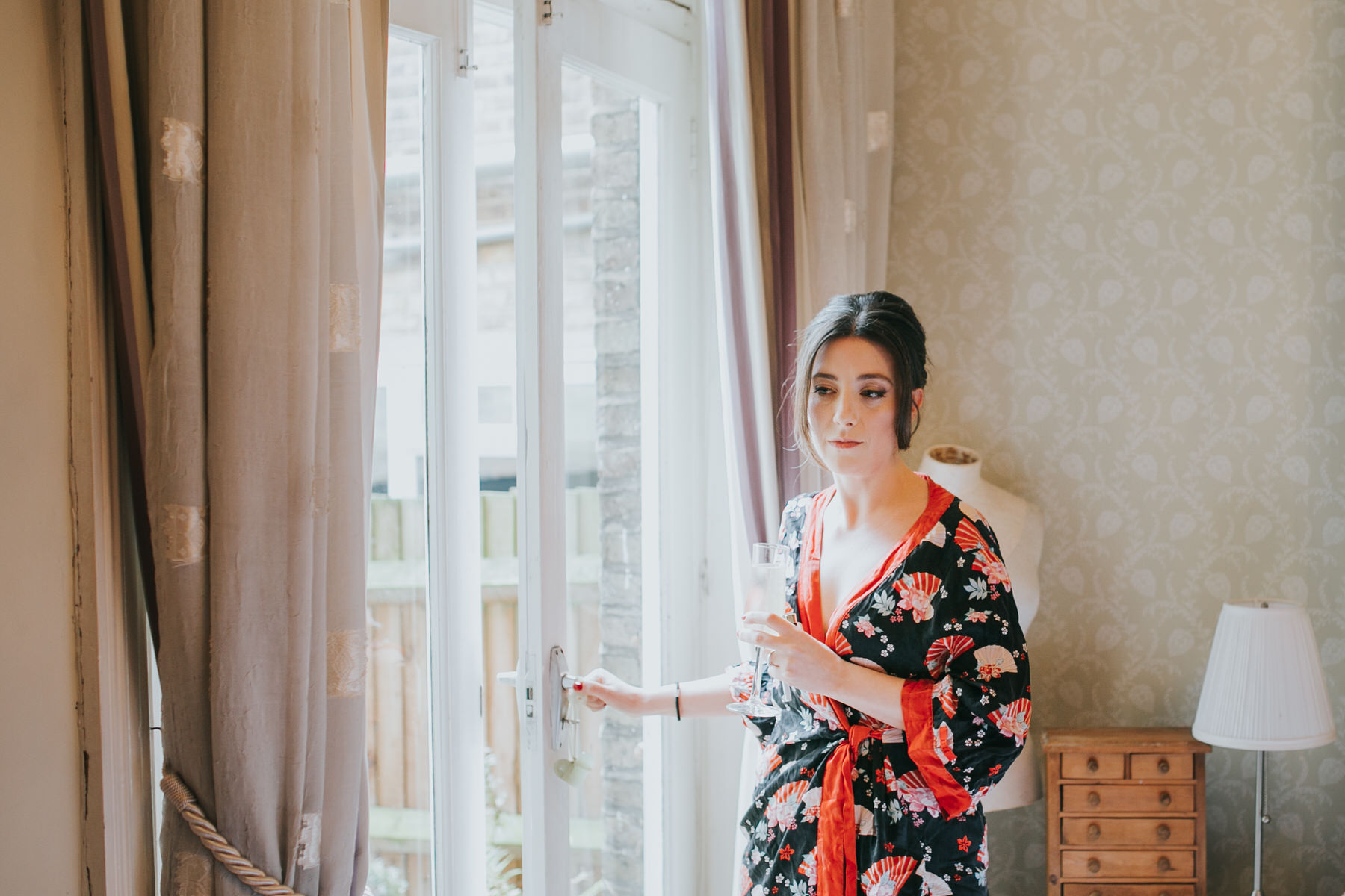 16-bride taking a moment while getting ready.jpg