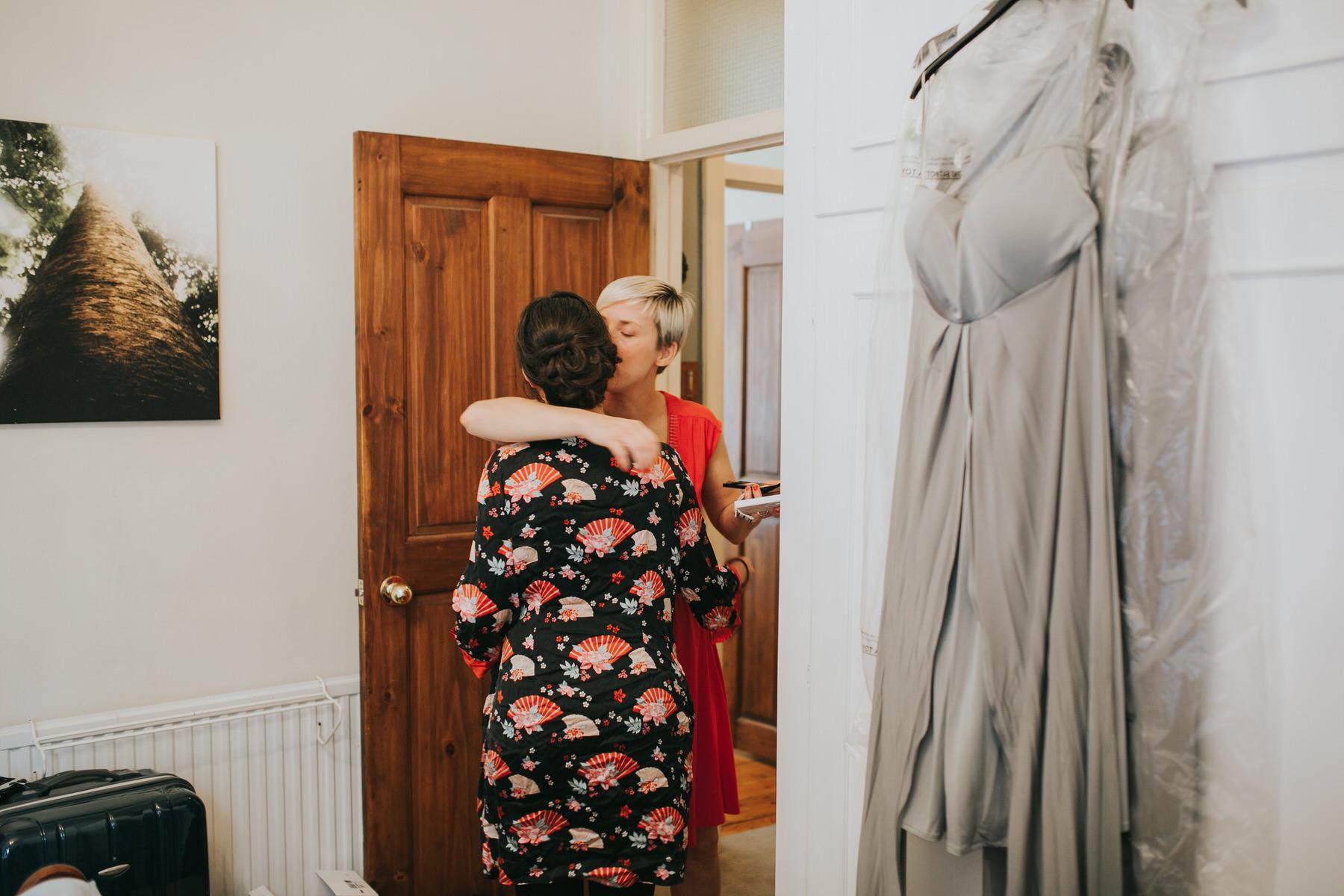 18-bride getting ready bridesmaid hugs.jpg