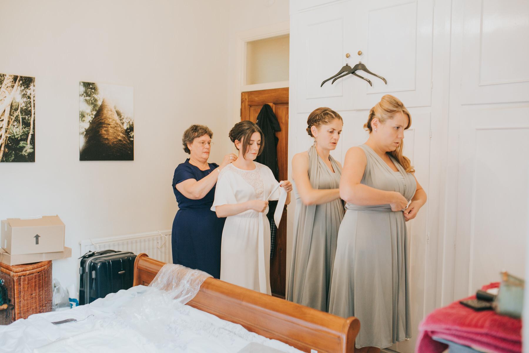 22-bride getting ready Minna wedding dress.jpg