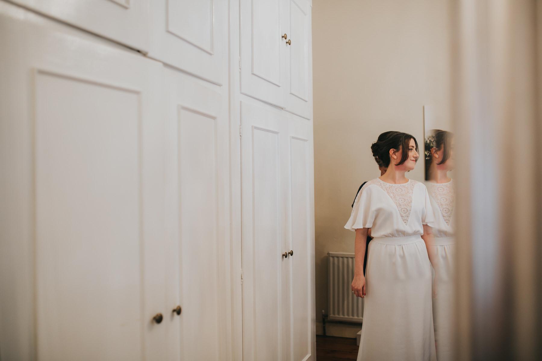 26-bride getting ready Minna wedding dress.jpg