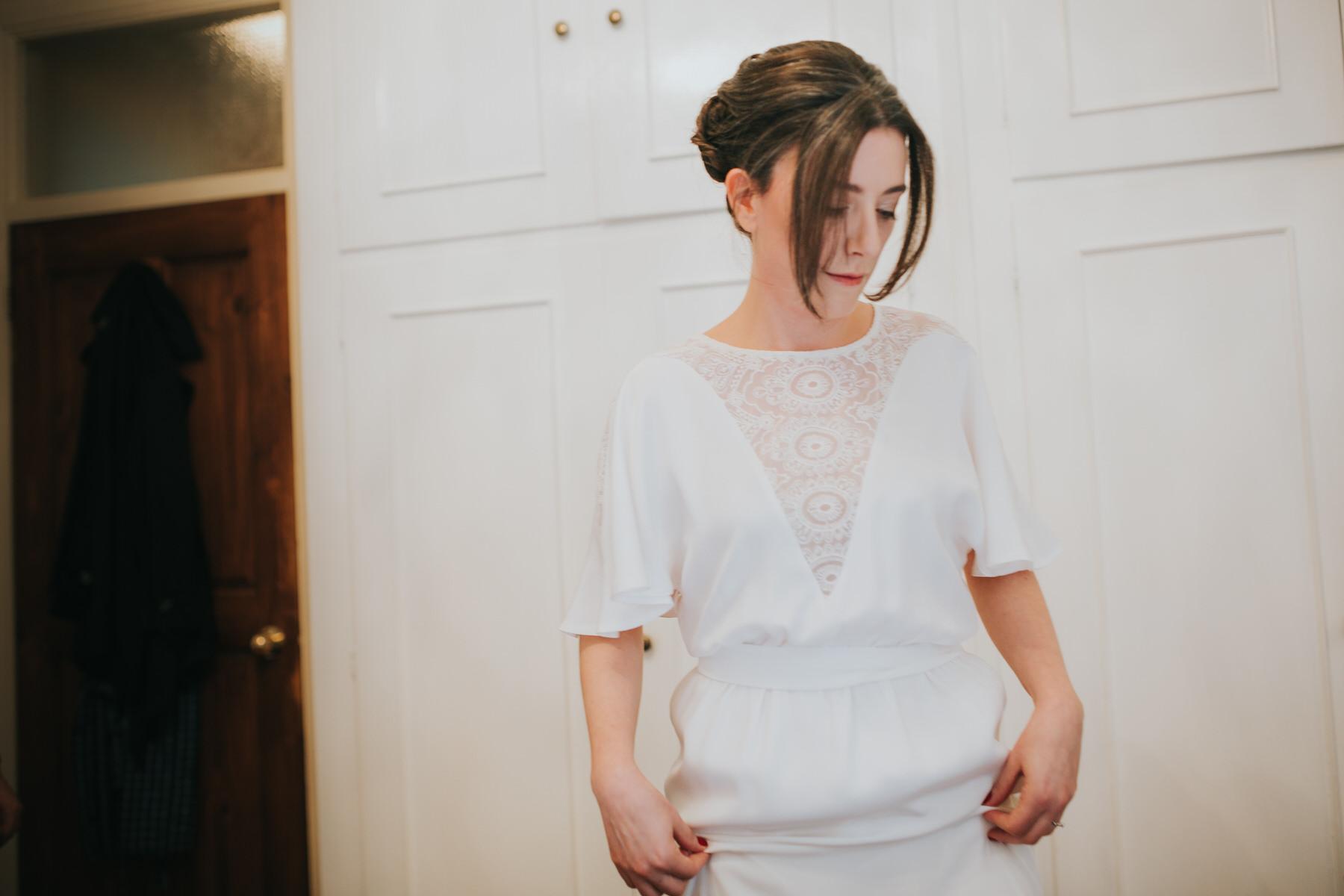 28-bride getting ready Minna wedding dress.jpg