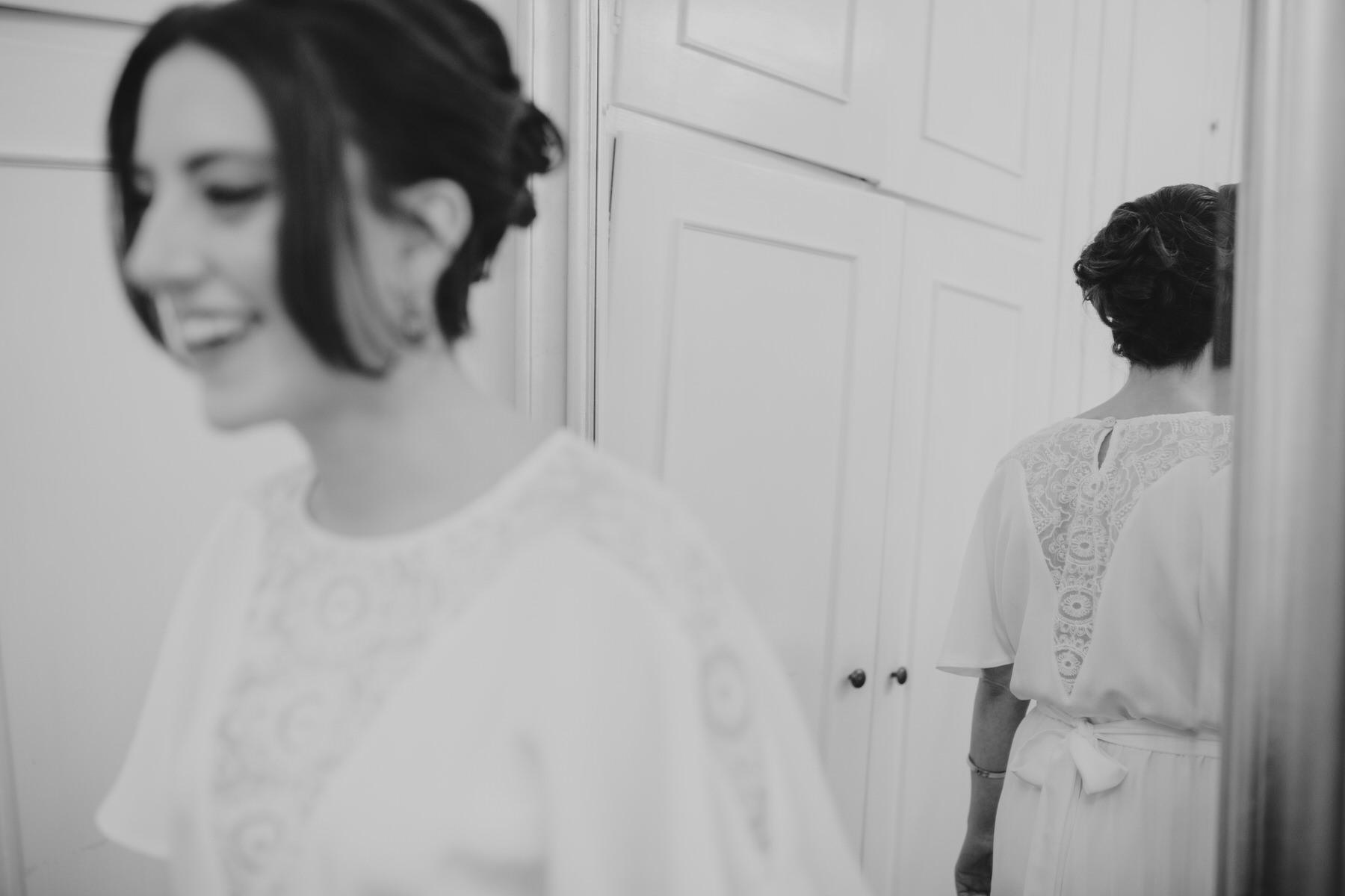 36-bride B&W Minna wedding dress in mirror.jpg