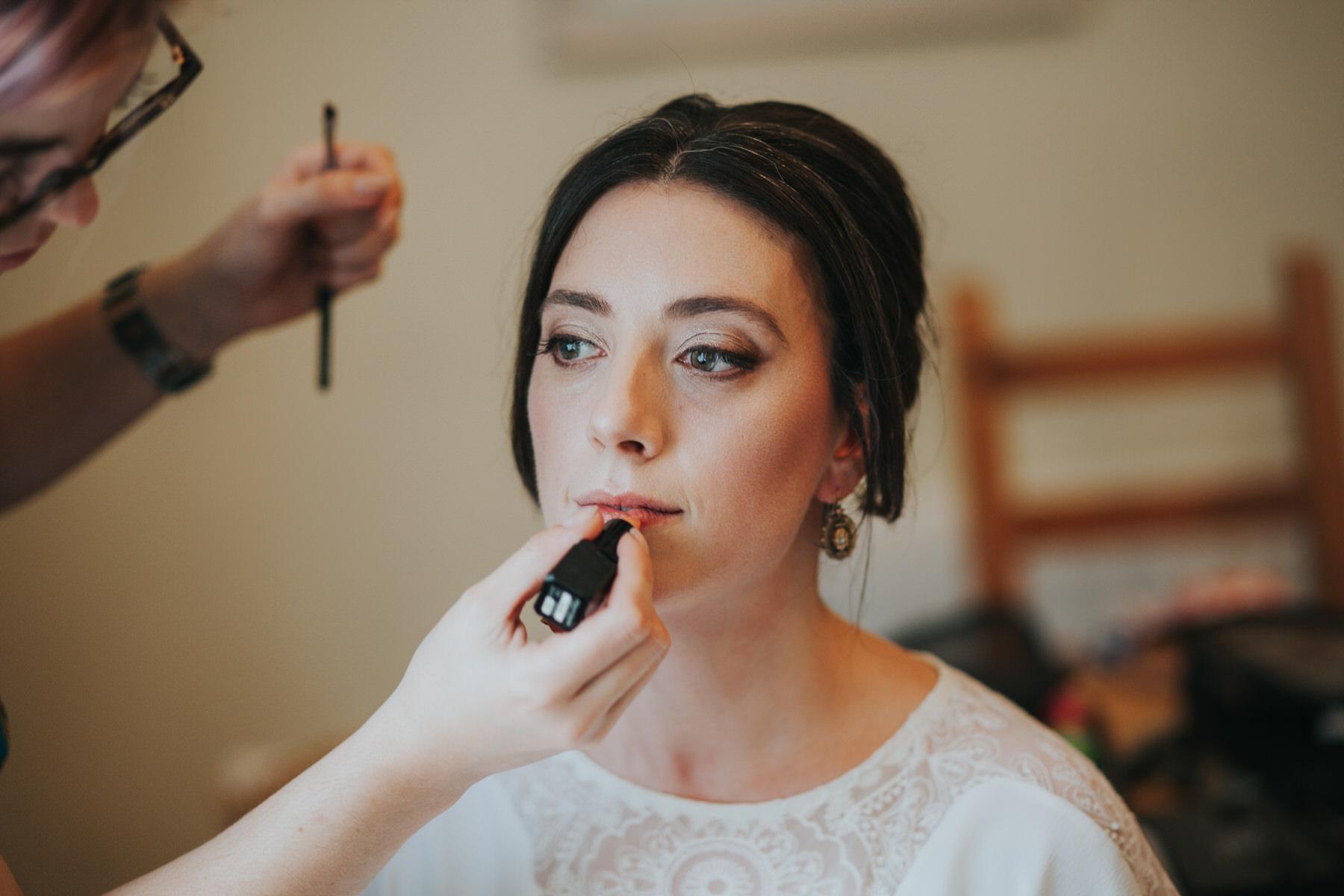 44-bride lipstick touch up Minna wedding dress.jpg