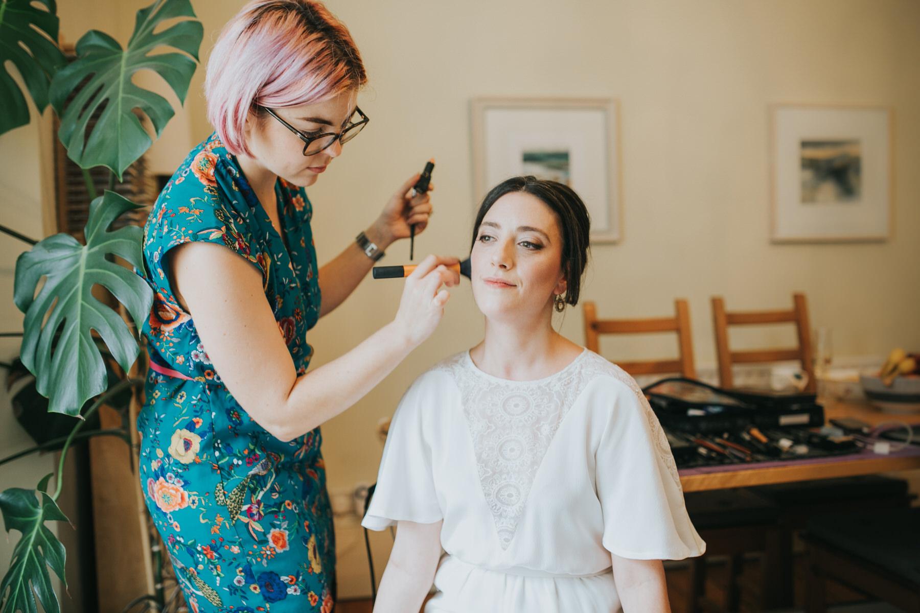 46-makeup artist bride getting ready Minna wedding dress.jpg