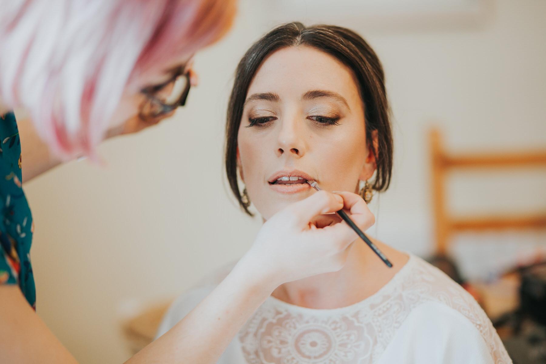 47-bride lipstick application Minna wedding dress.jpg