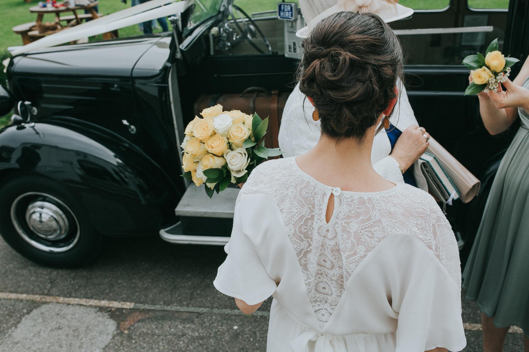 60-bride wearing Minna wedding dress yellow rose bouquet Belair House.jpg