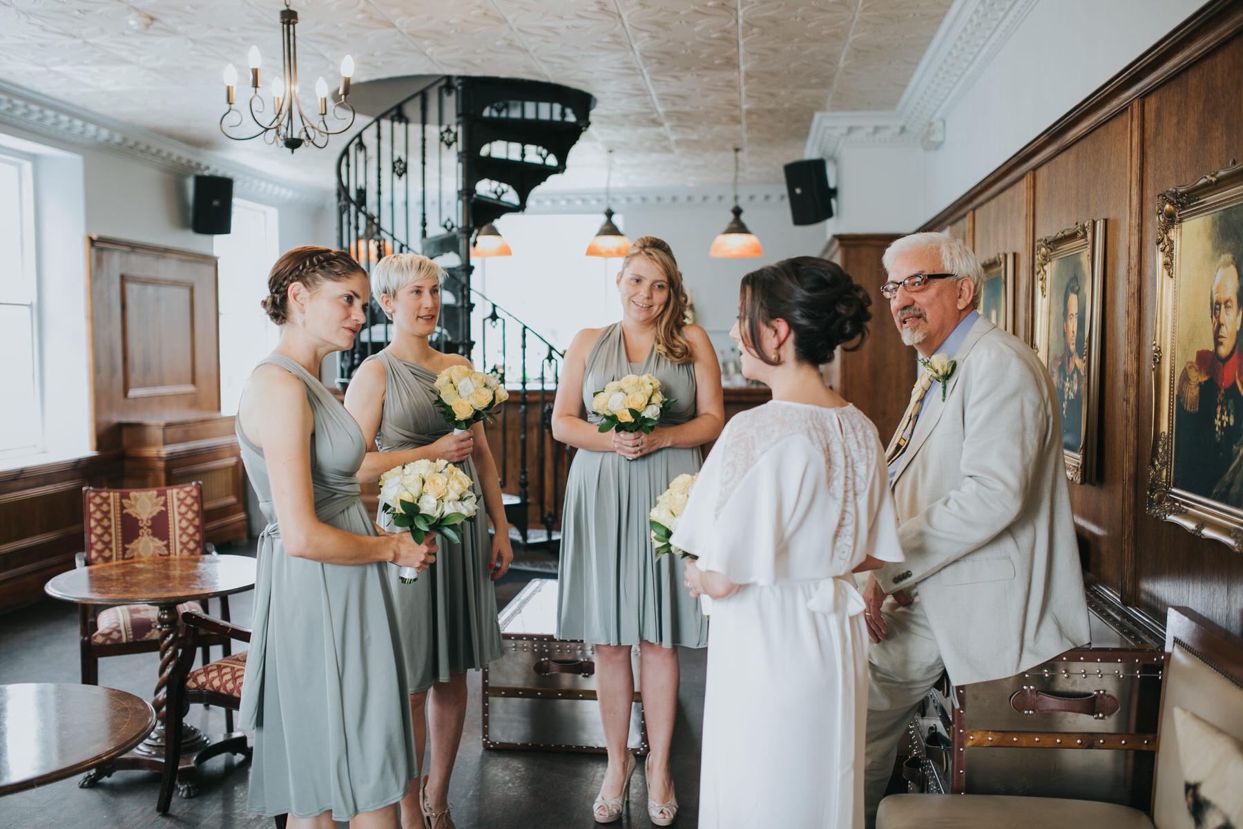 72-bride waiting briesmaids upstairs Belair House.jpg