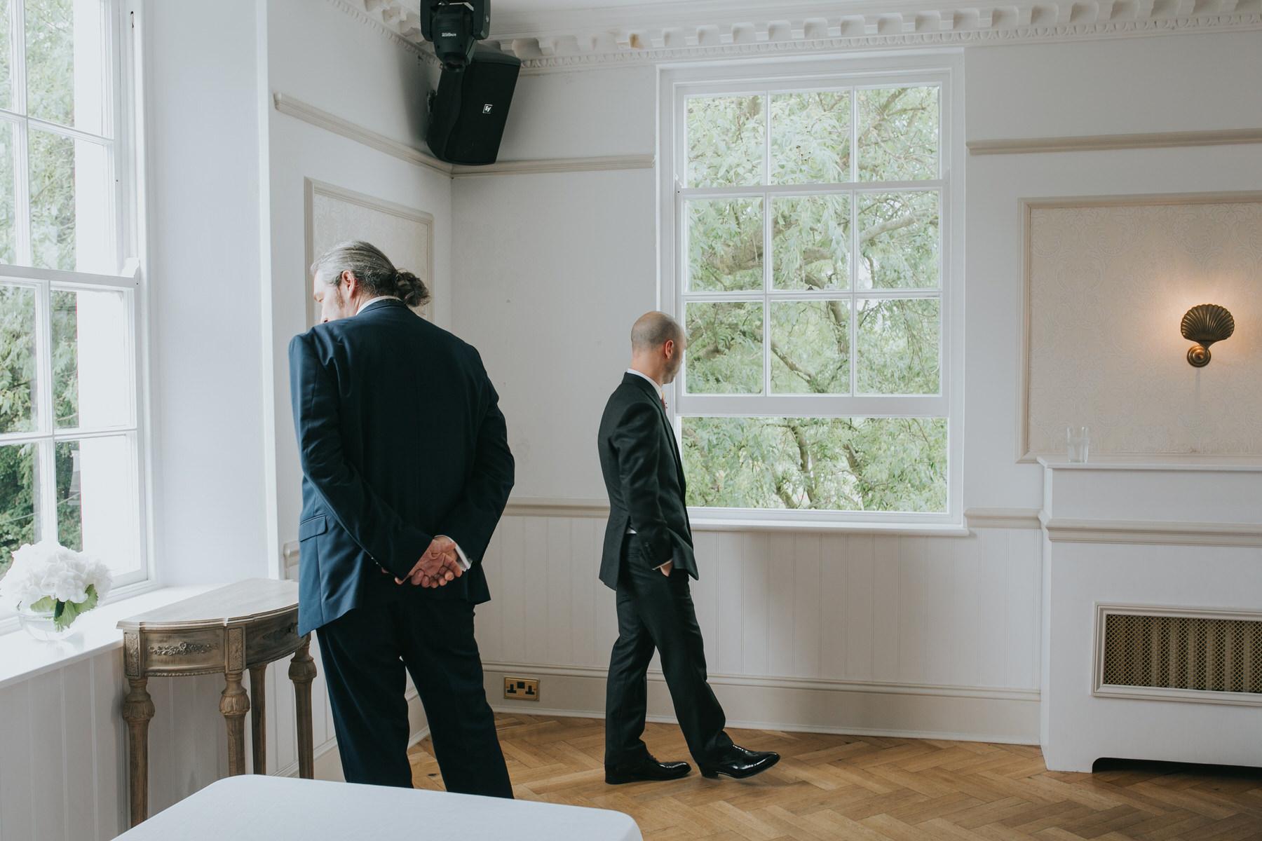 77-groom waiting Belair House ceremony room.jpg