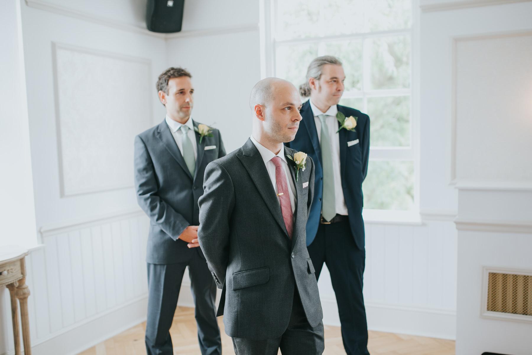 83-groom groomsmen waiting Belair House wedding ceremony.jpg
