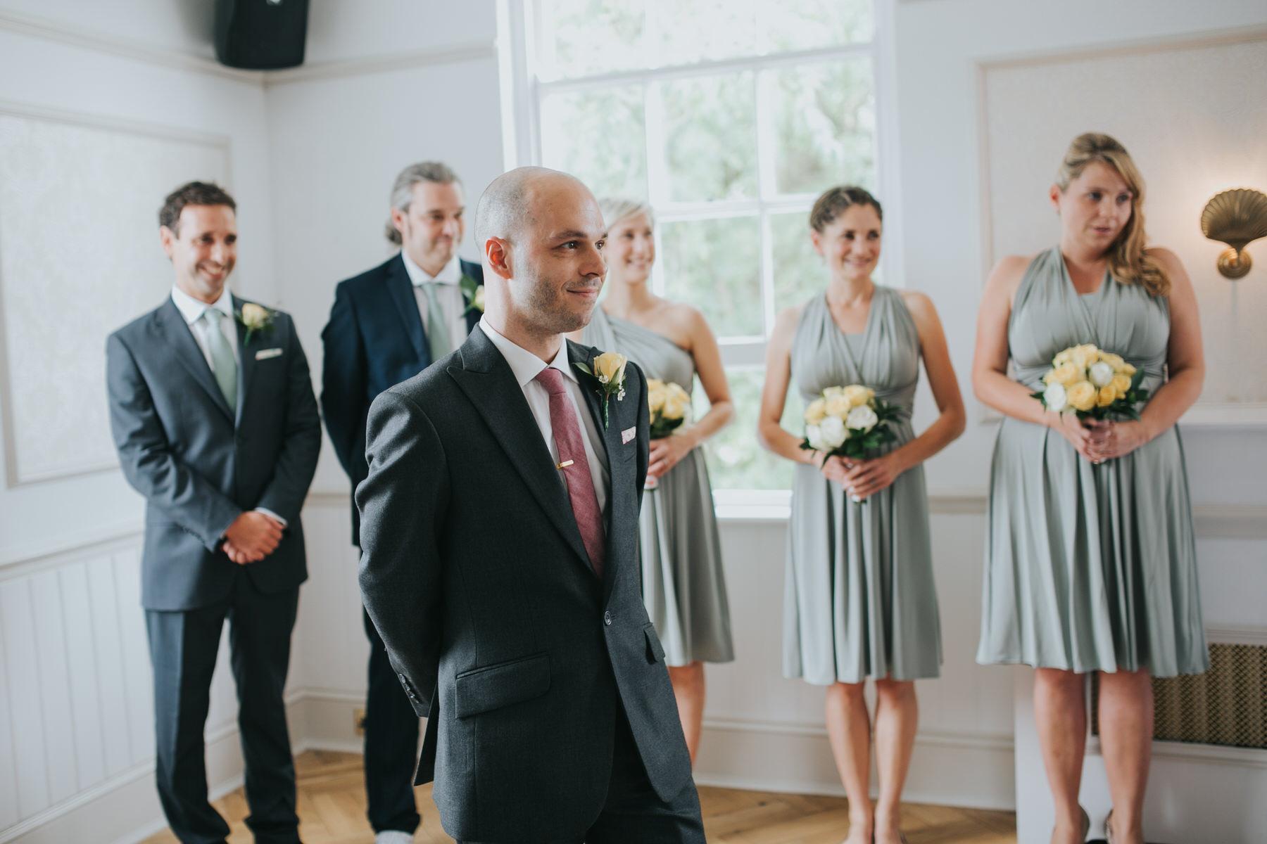 88 groom waiting bestmen bridesmaids Dulwich marriage ceremony.jpg