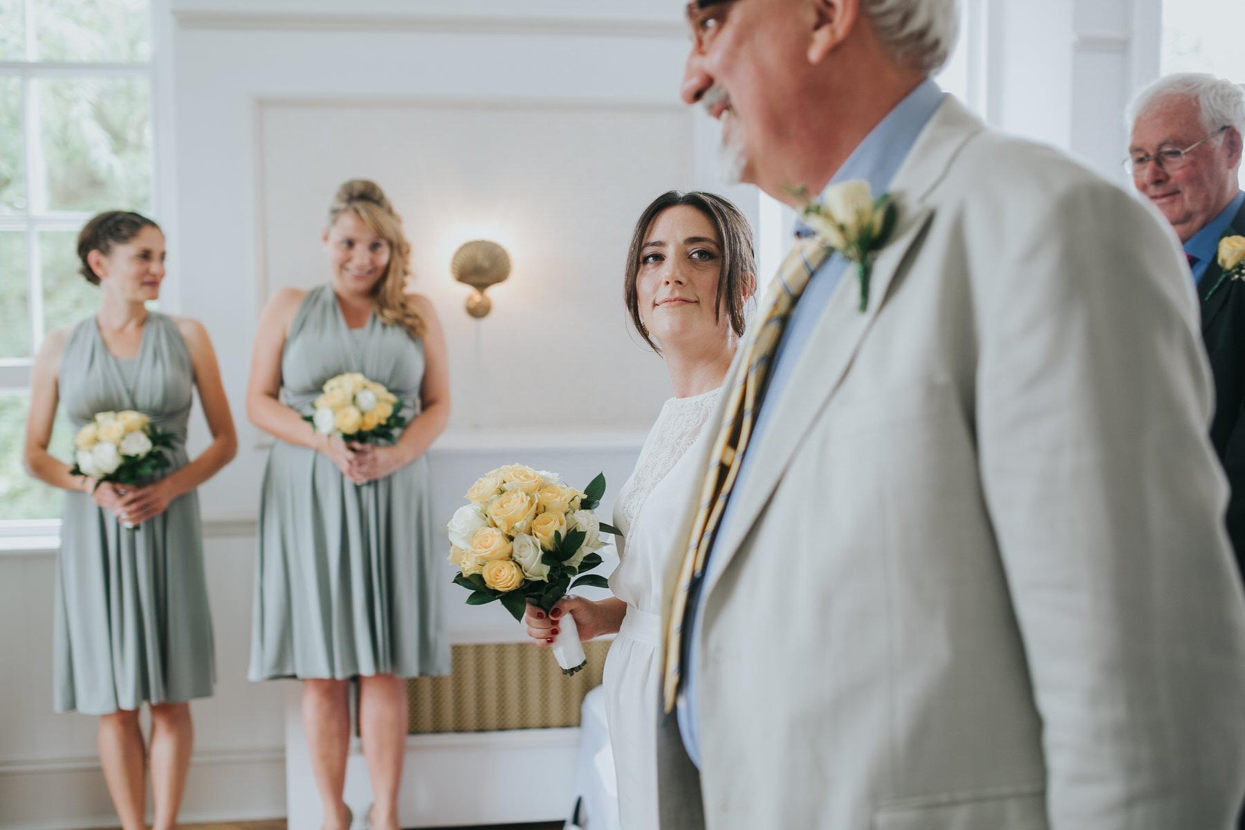 89 bride glances at dad Belair House wedding ceremony.jpg