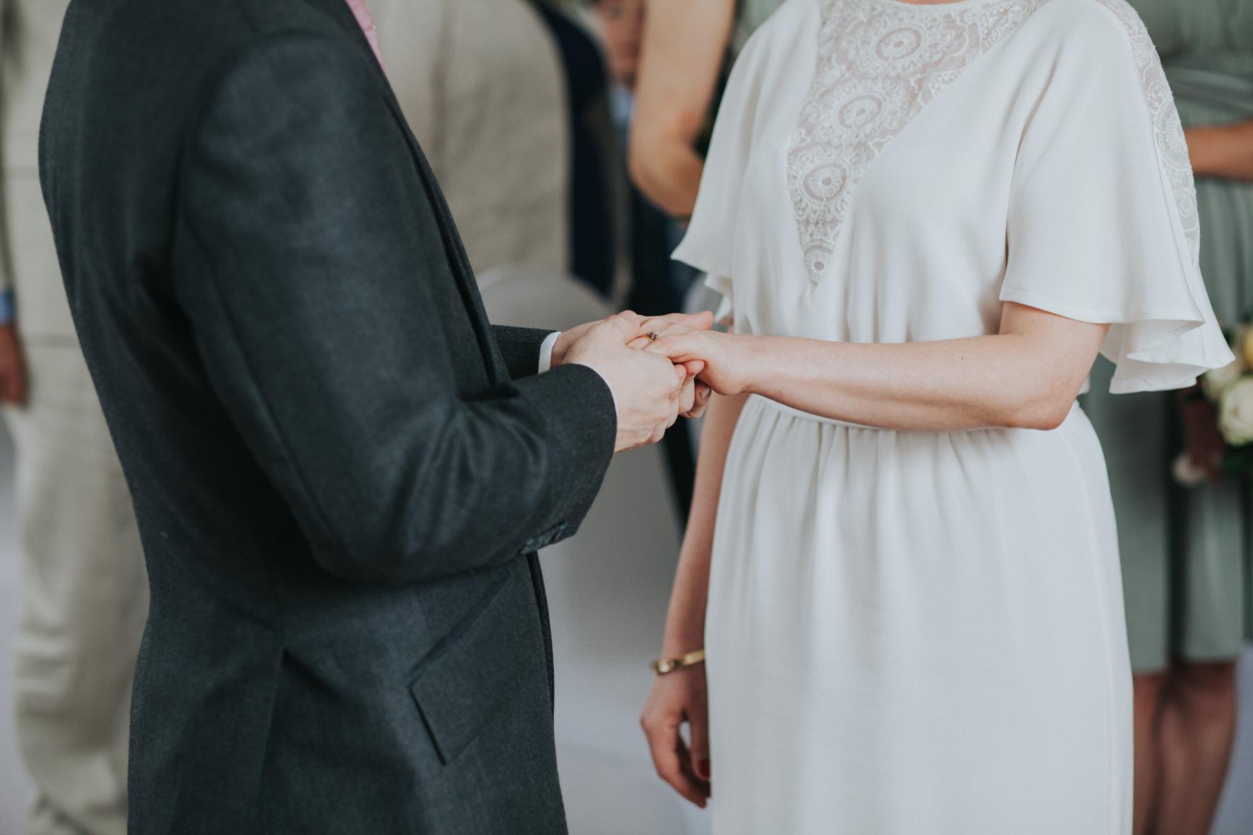 102 groom places wedding ring brides finger.jpg