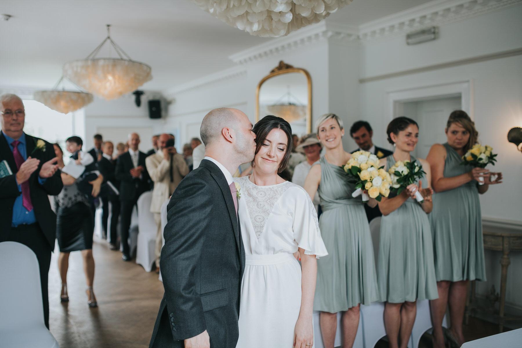 107 groom kisses bride London wedding reportage photo.jpg
