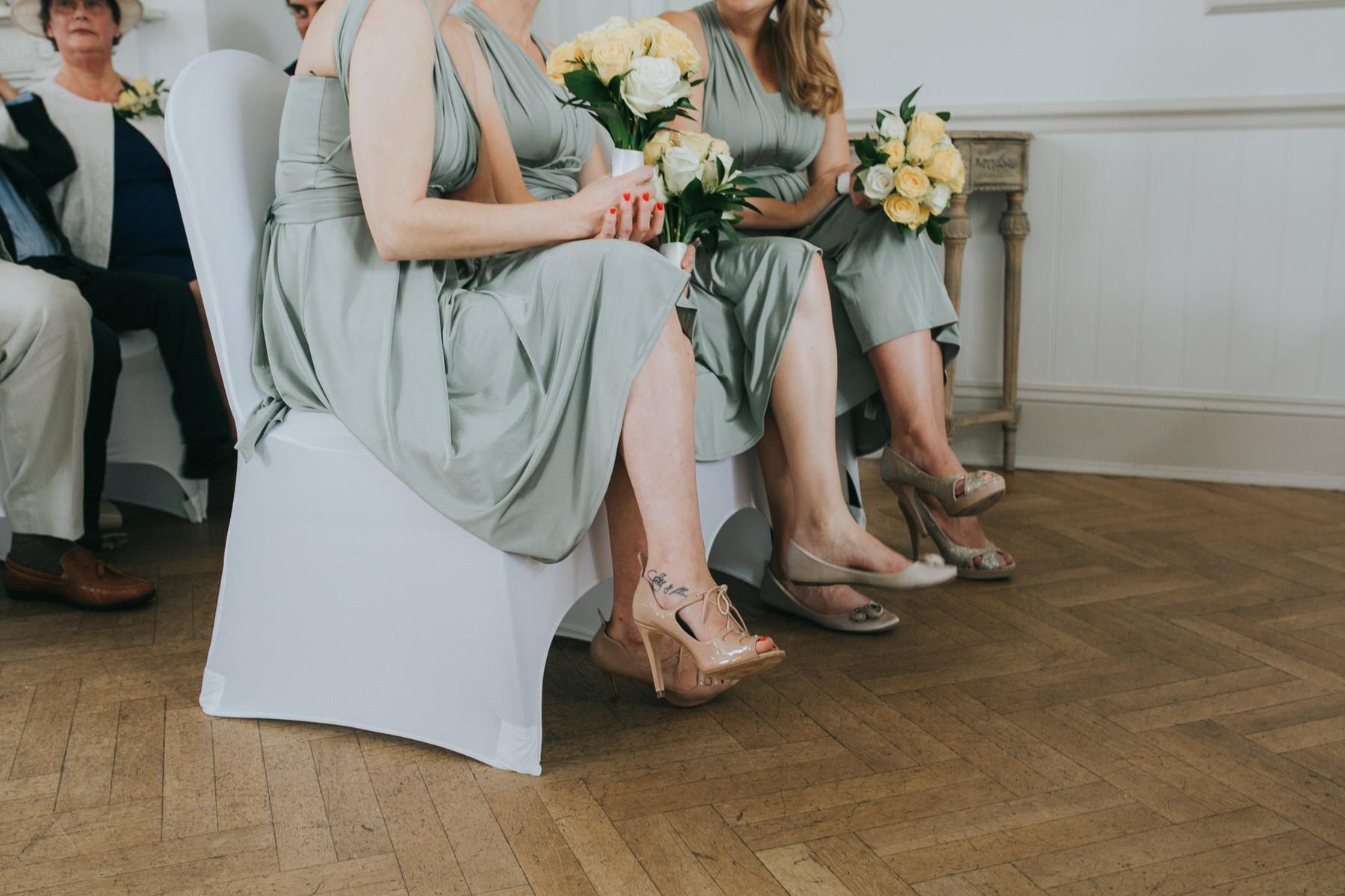 110 bridesmaids shoe shot parquet floor Belair House.jpg