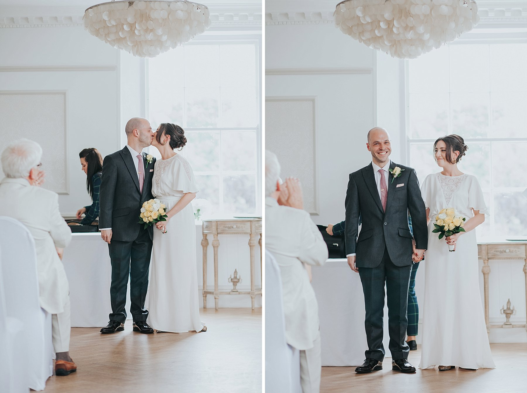 114-Belair House wedding ceremony first kiss.jpg