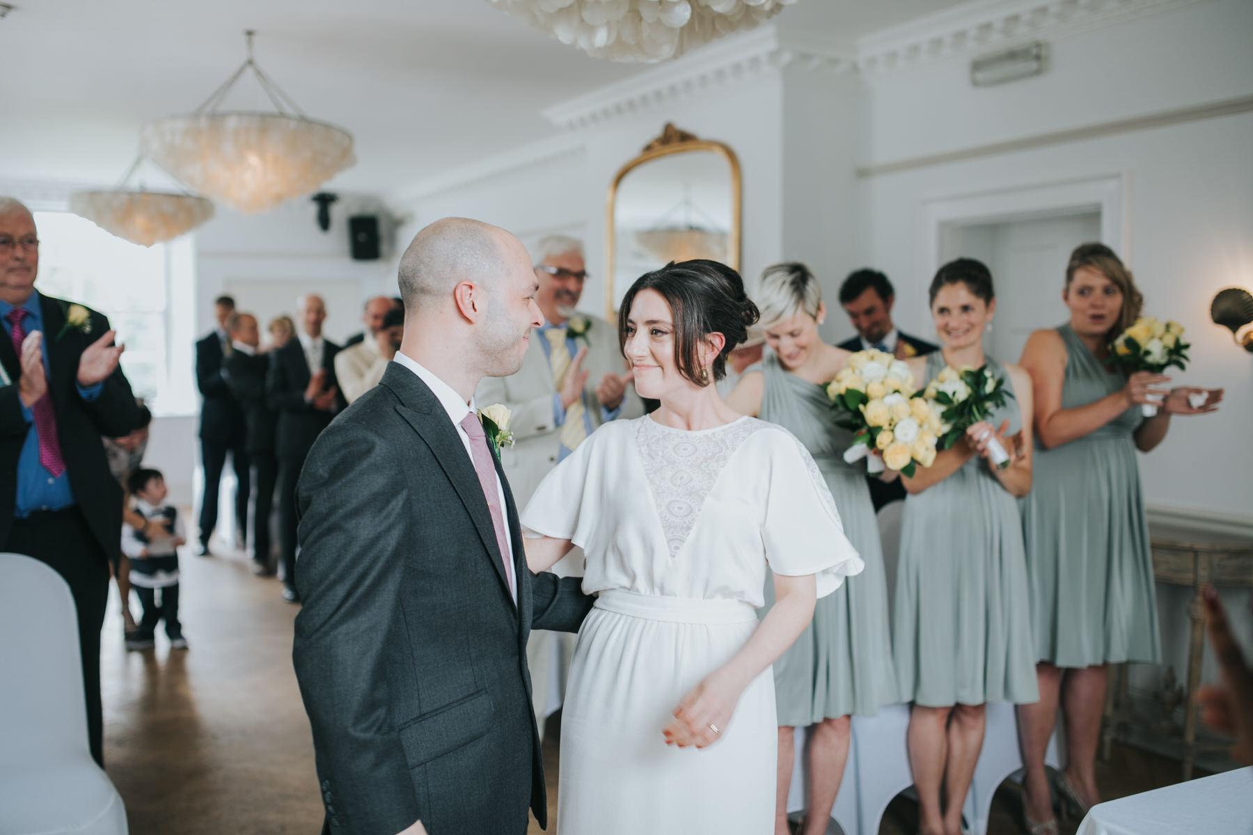 119 ecstatic bride groom just married London documentary wedding photographer.jpg