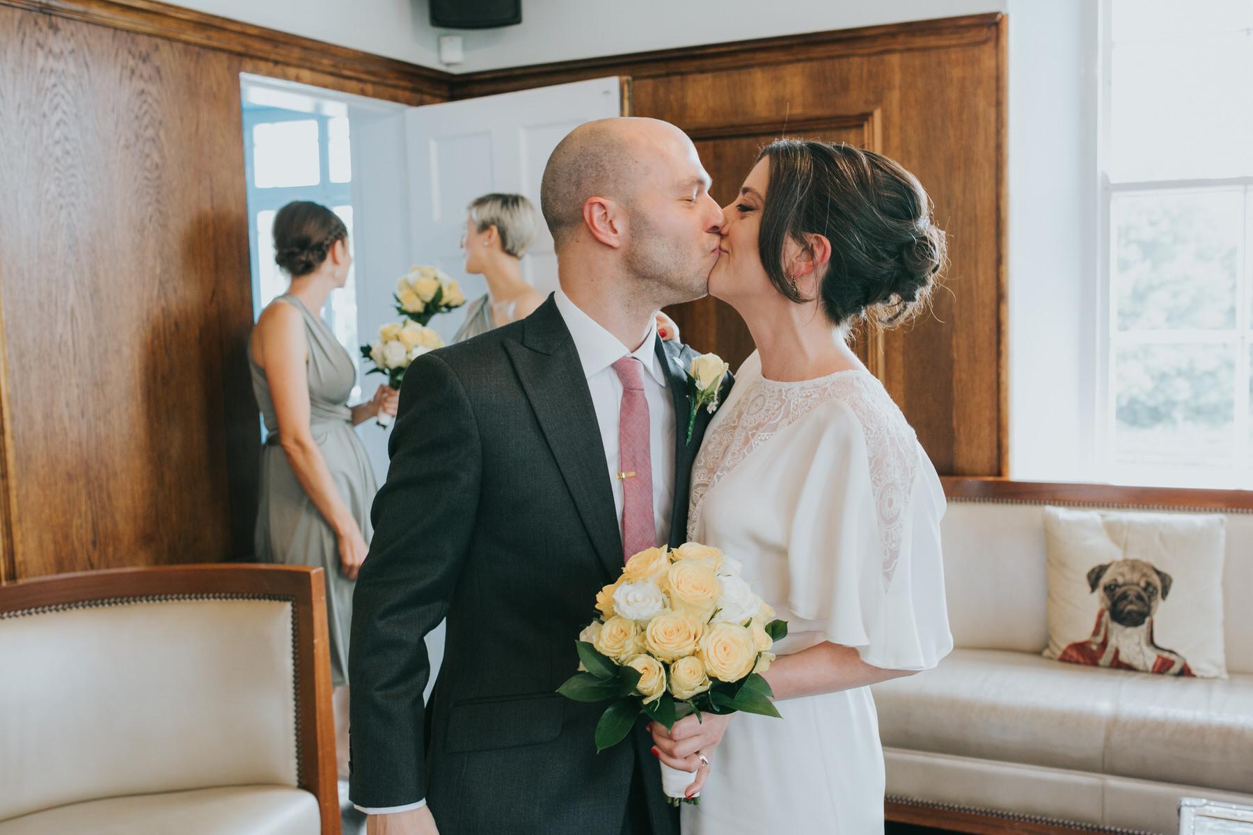 120 bride groom kissing wedding reportage.jpg