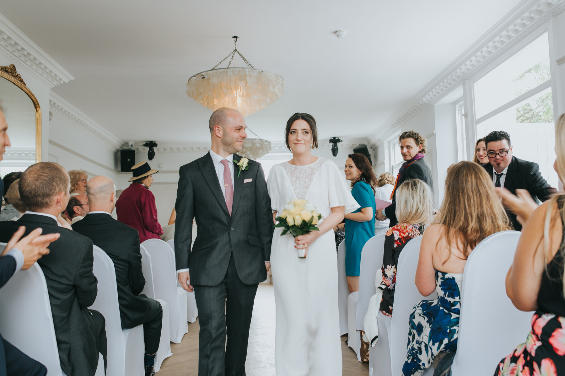 116 newly married couple exit Belair House wedding ceremony.jpg
