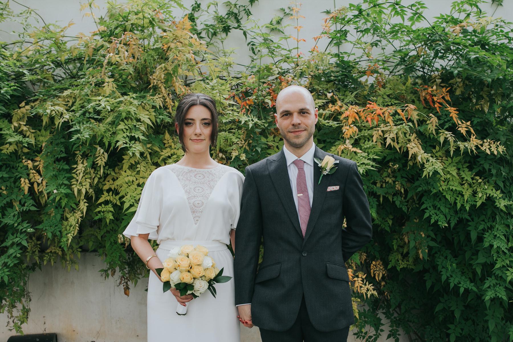 128 green orange fern ivy bride groom portrait.jpg