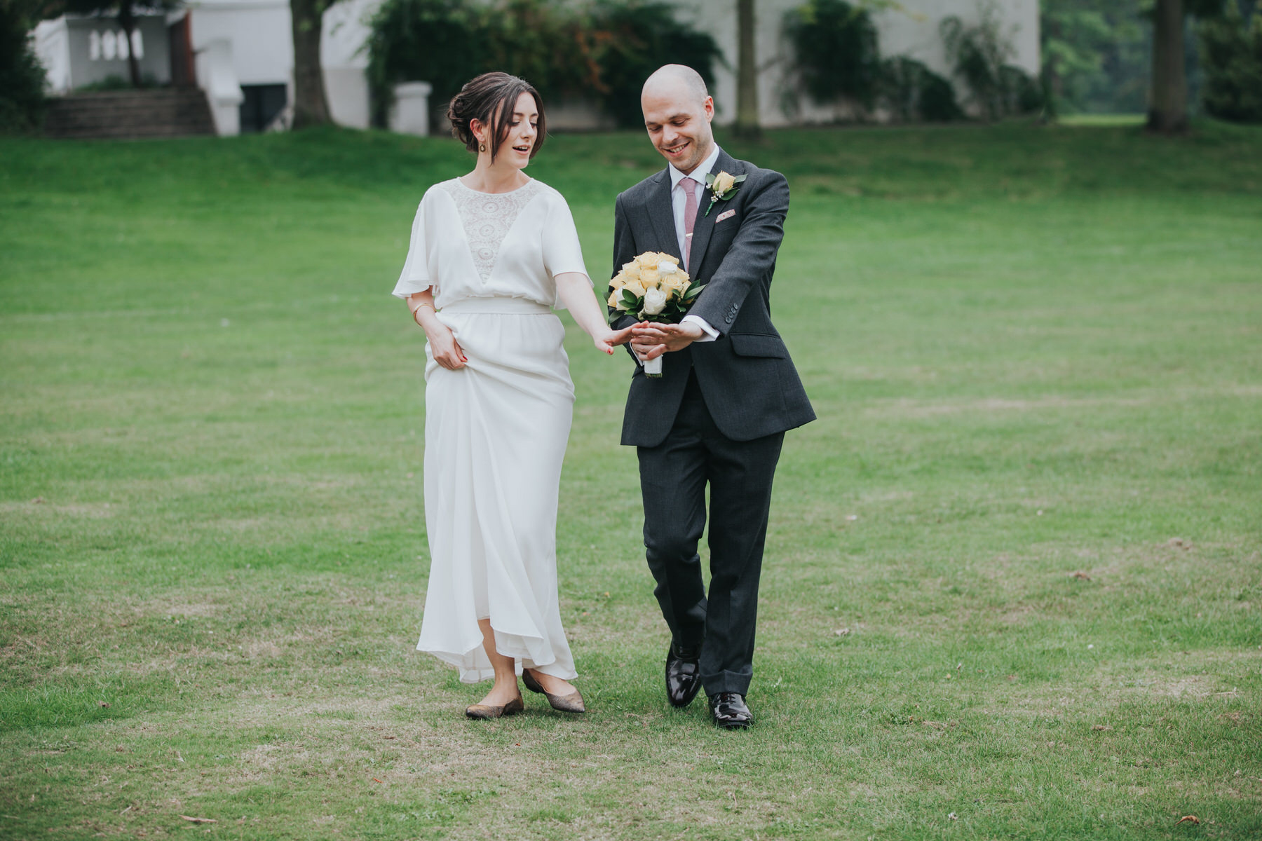 143 bride groom admiring their wedding rings.jpg