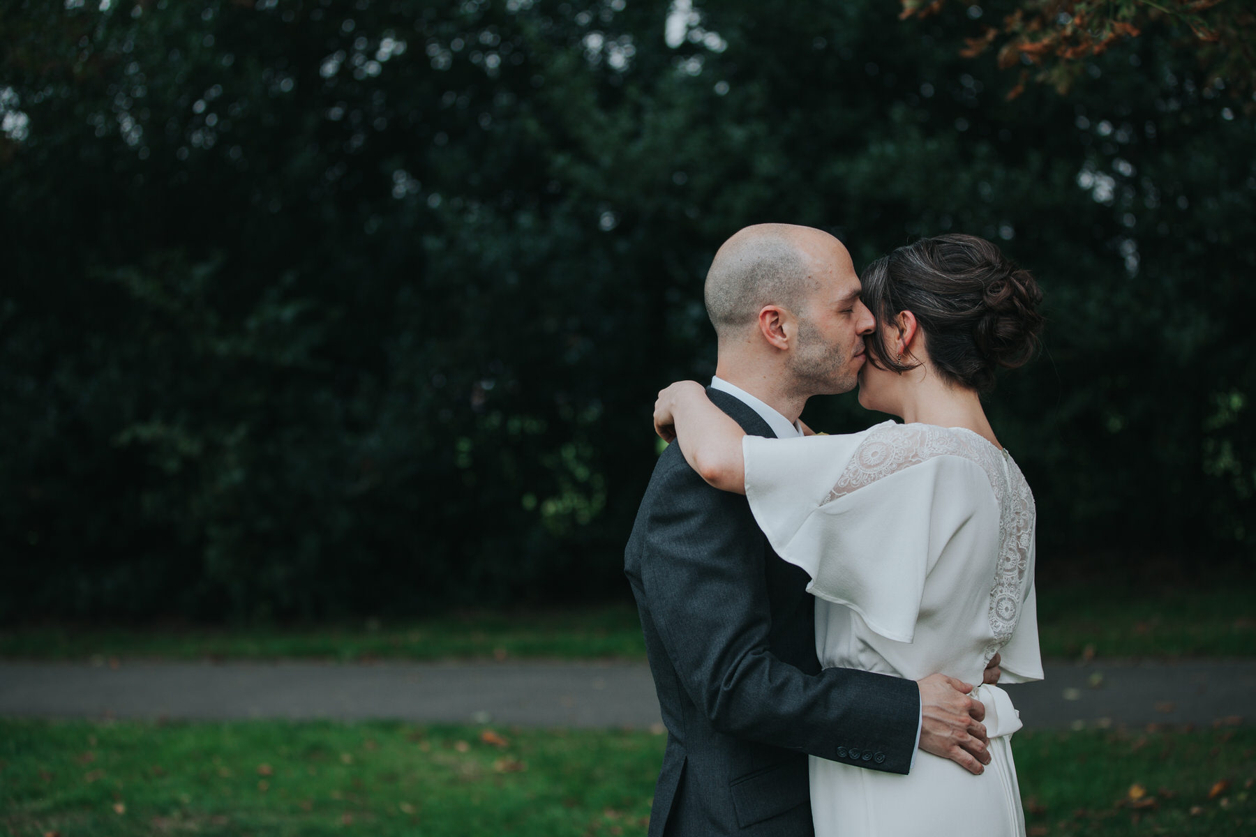 148 Dulwich Belair Park bride groom embrace intimate moment.jpg