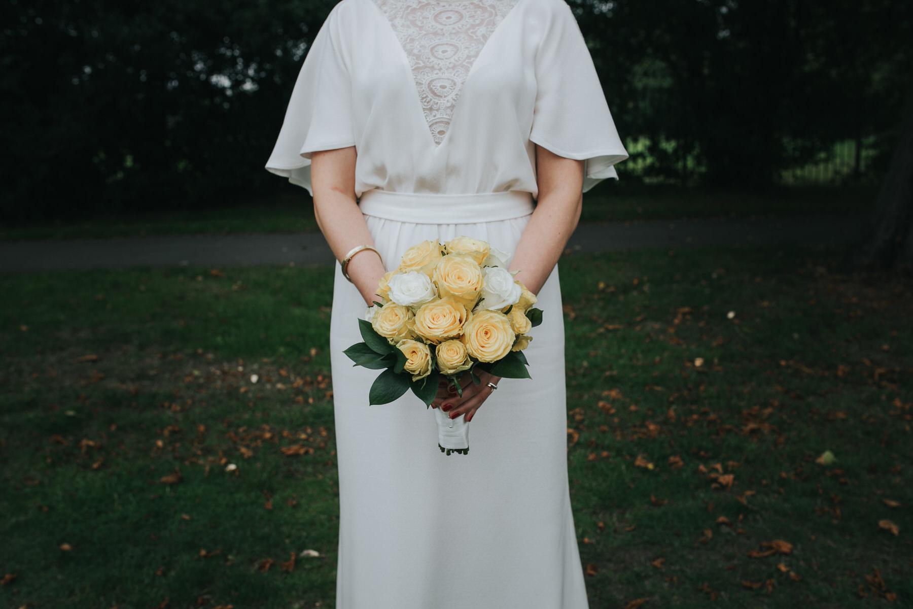 157 London bride portrait yellow rose bouquet.jpg