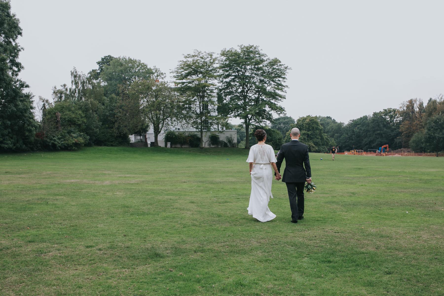 162 wedding couple walking towards Belair House.jpg