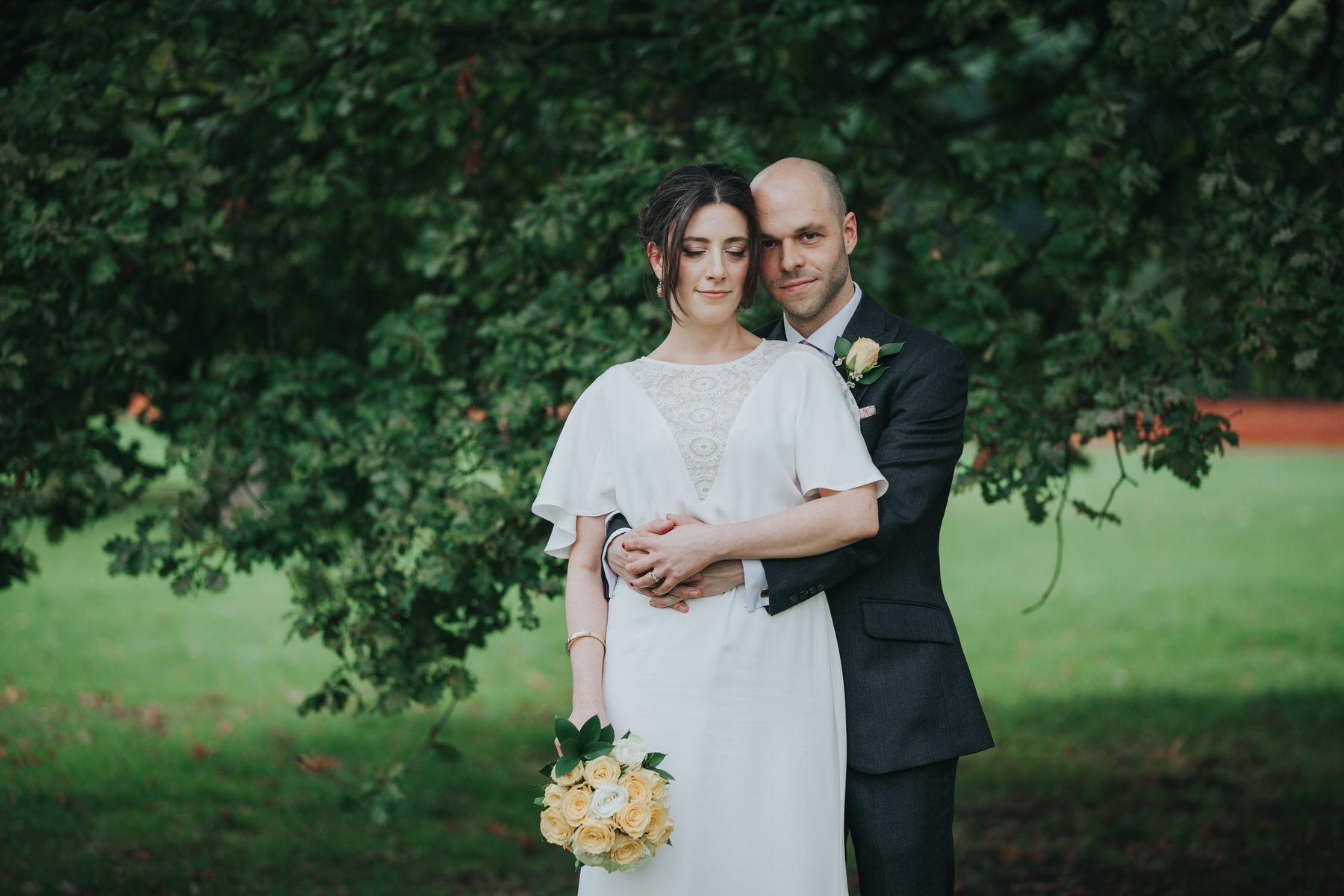 171 bride groom intimate wedding portraits under tree.jpg