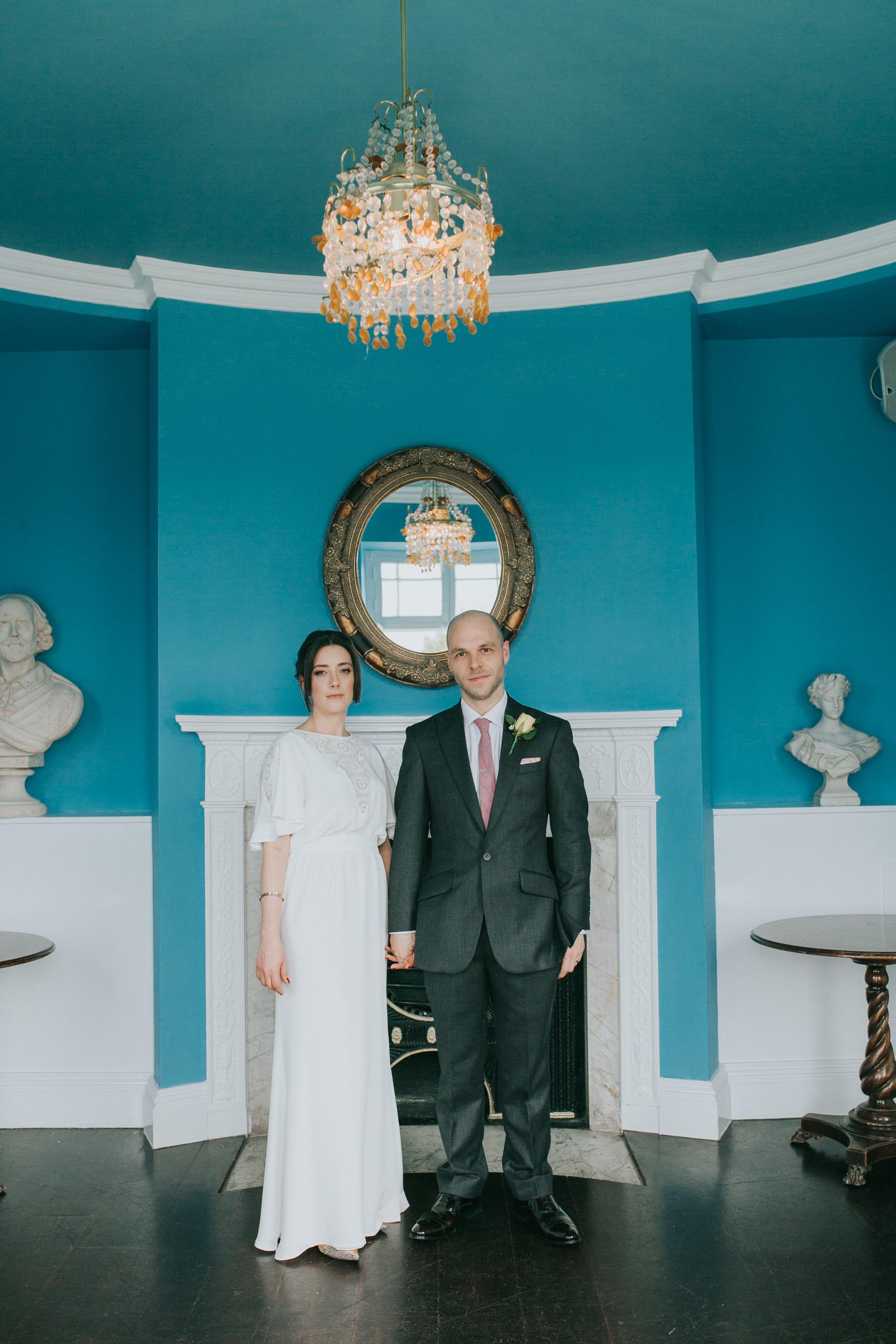 212 Belair House blue room wedding couple pose.jpg