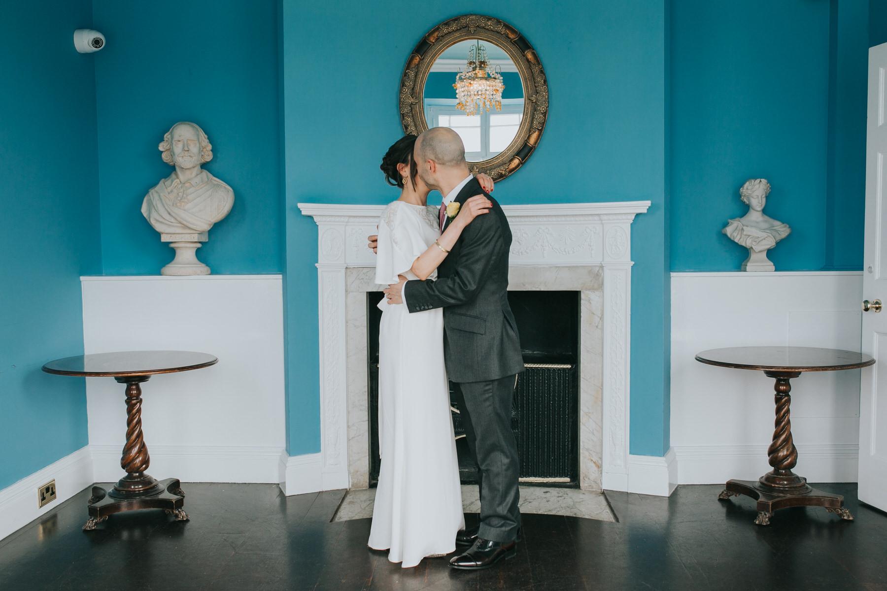 214 Belair House blue room bride groom embracing moments over mountains.jpg