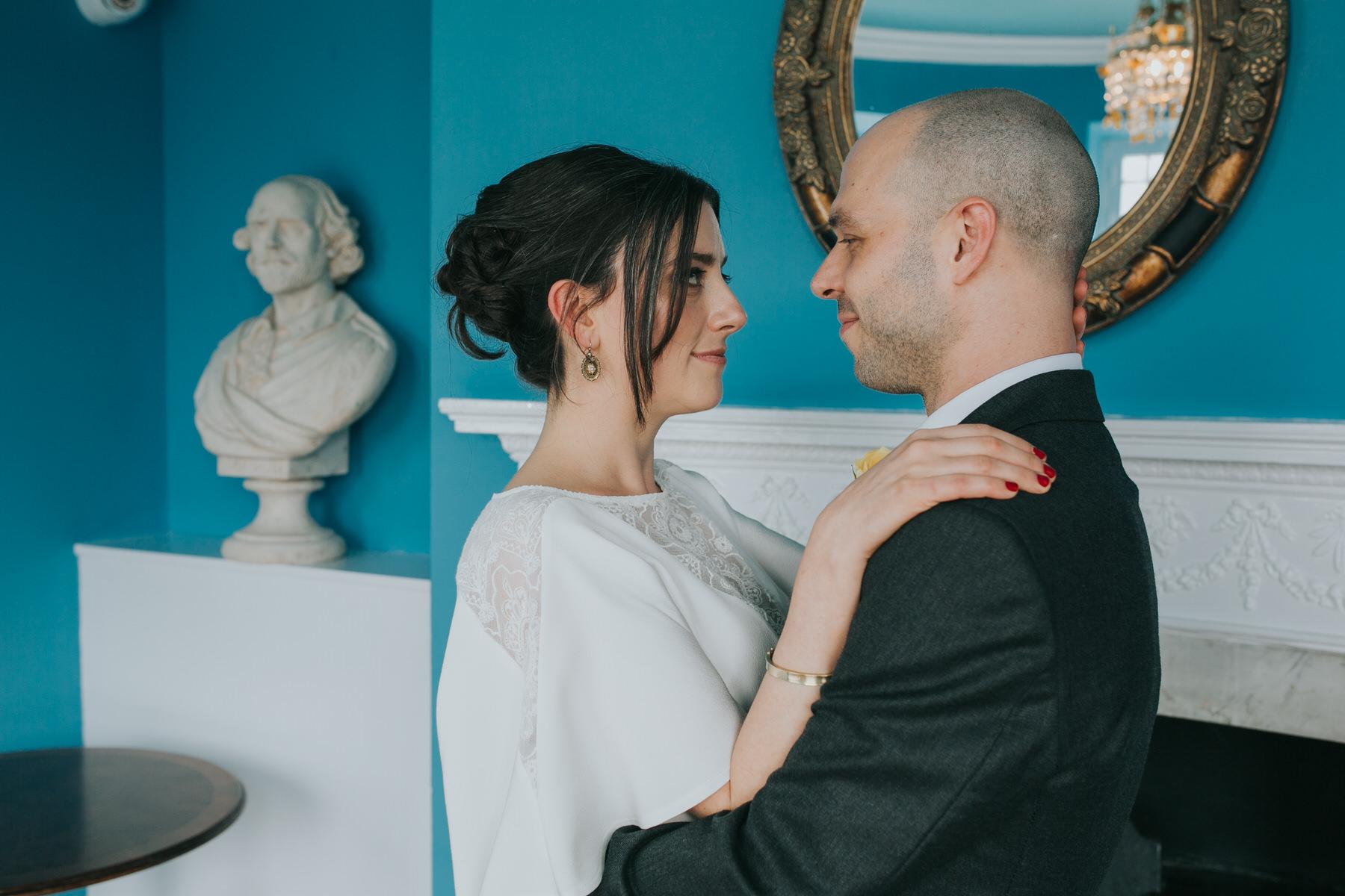 215 Belair House bride groom reportage blue room.jpg