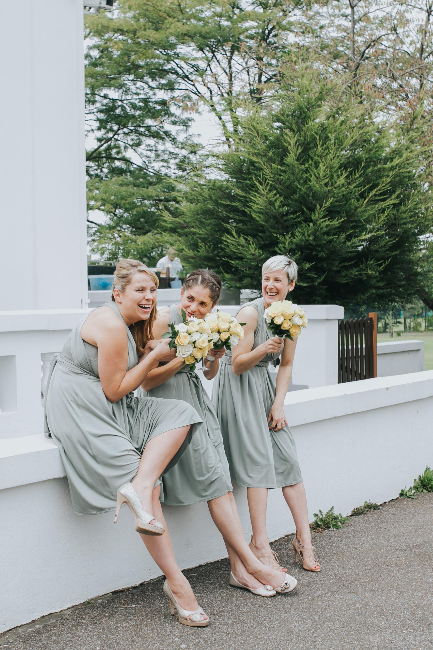 223 bridesmaids giggling outside Belair House documentary wedding.jpg
