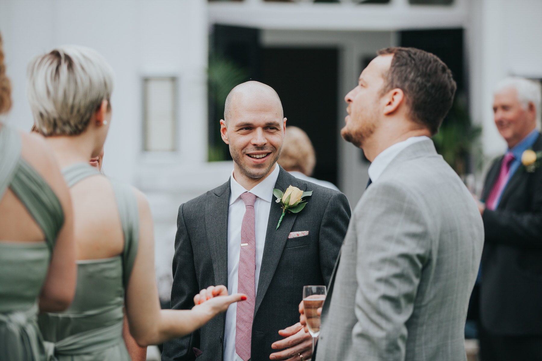 238 groom mingling with wedding guests reportage.jpg