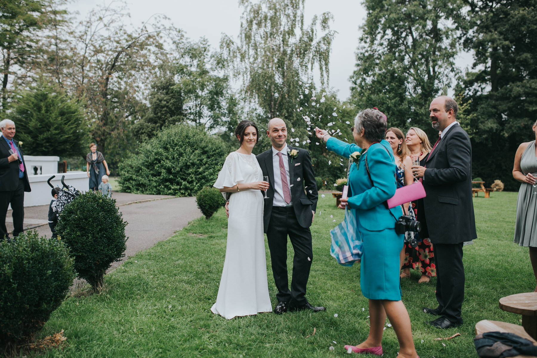 239 confettin on the lawn Belair House wedding.jpg