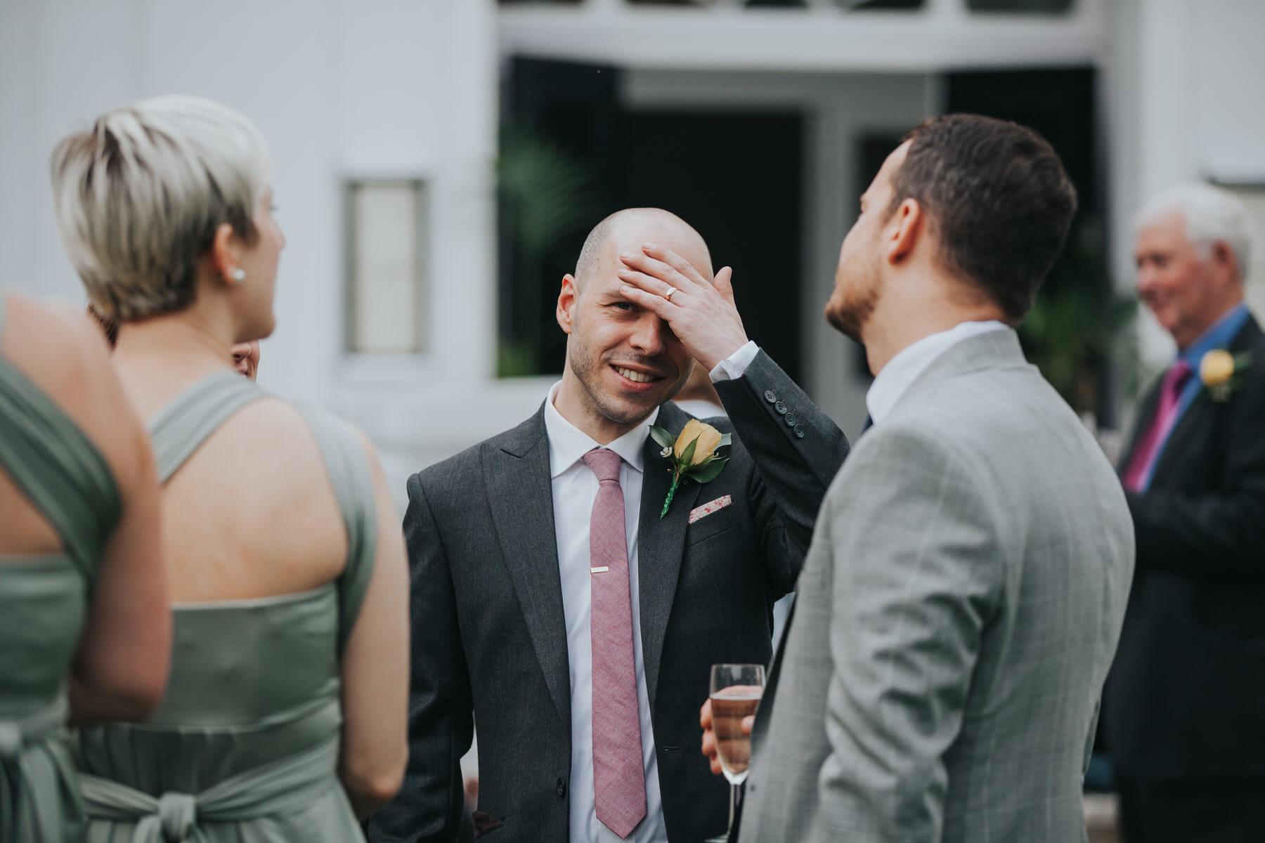 252 groom unposed wedding reportage Belair House.jpg