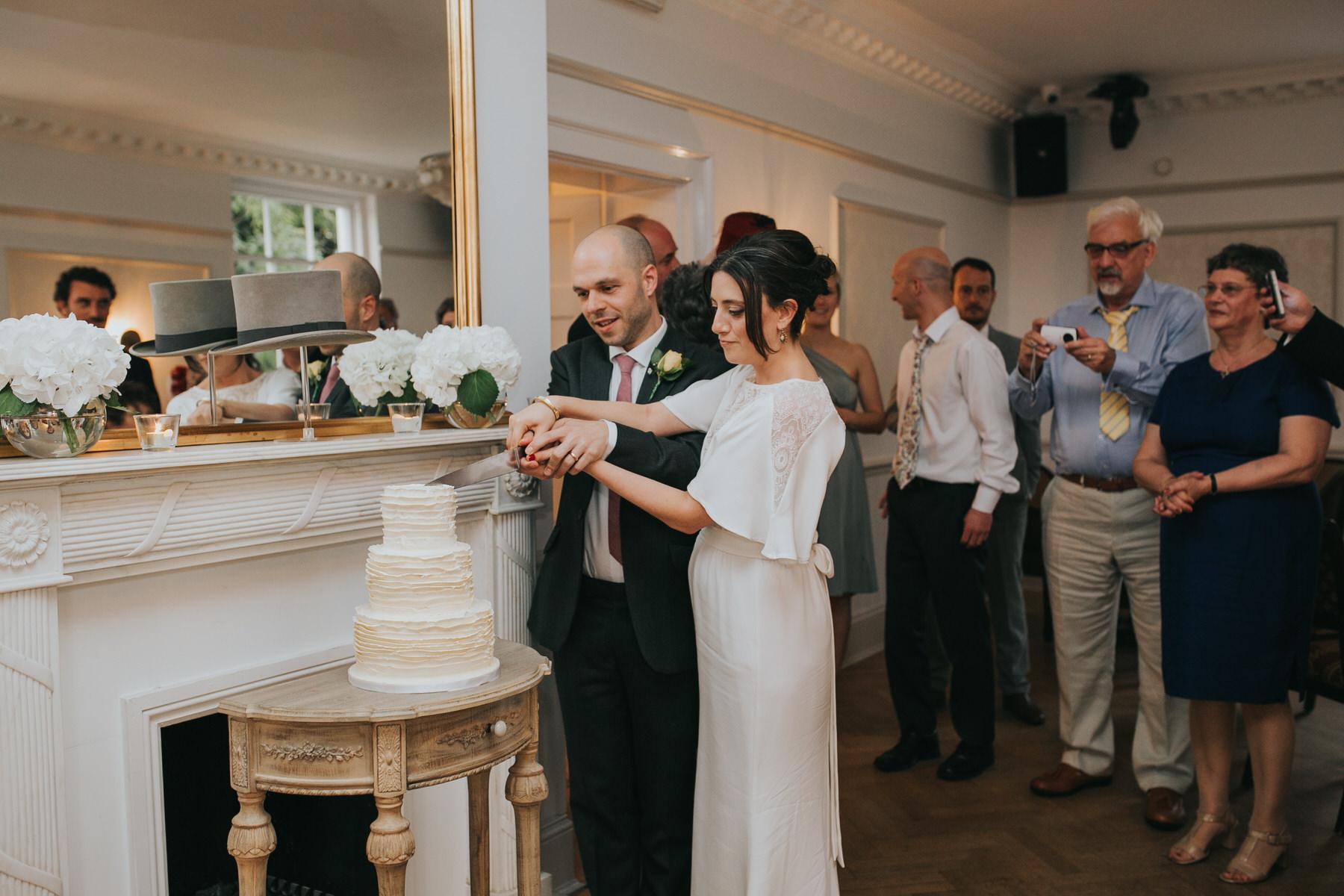 323-Belair House bride groom cut elegant minimalist cream cake.jpg