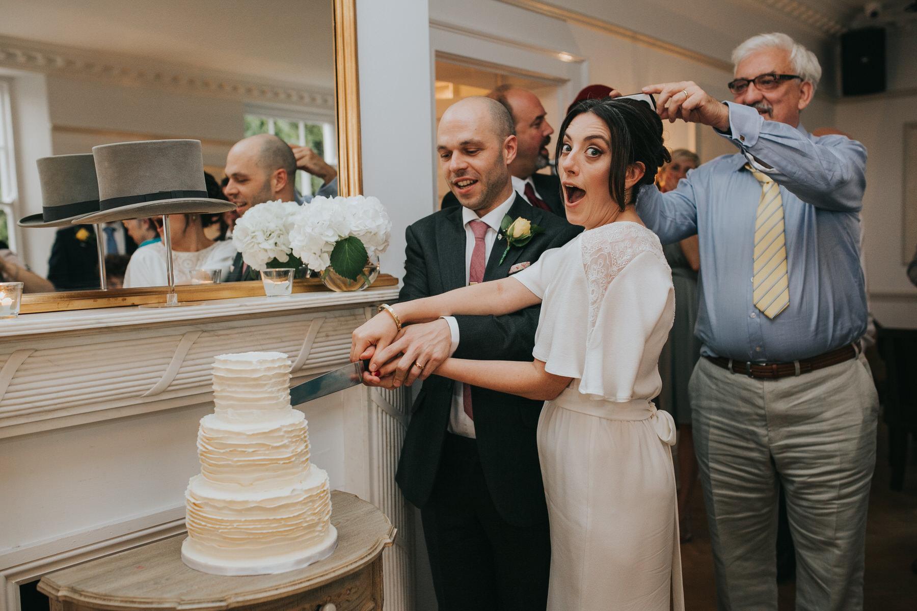 324-Belair House bride groom cut elegant minimalist cream cake.jpg