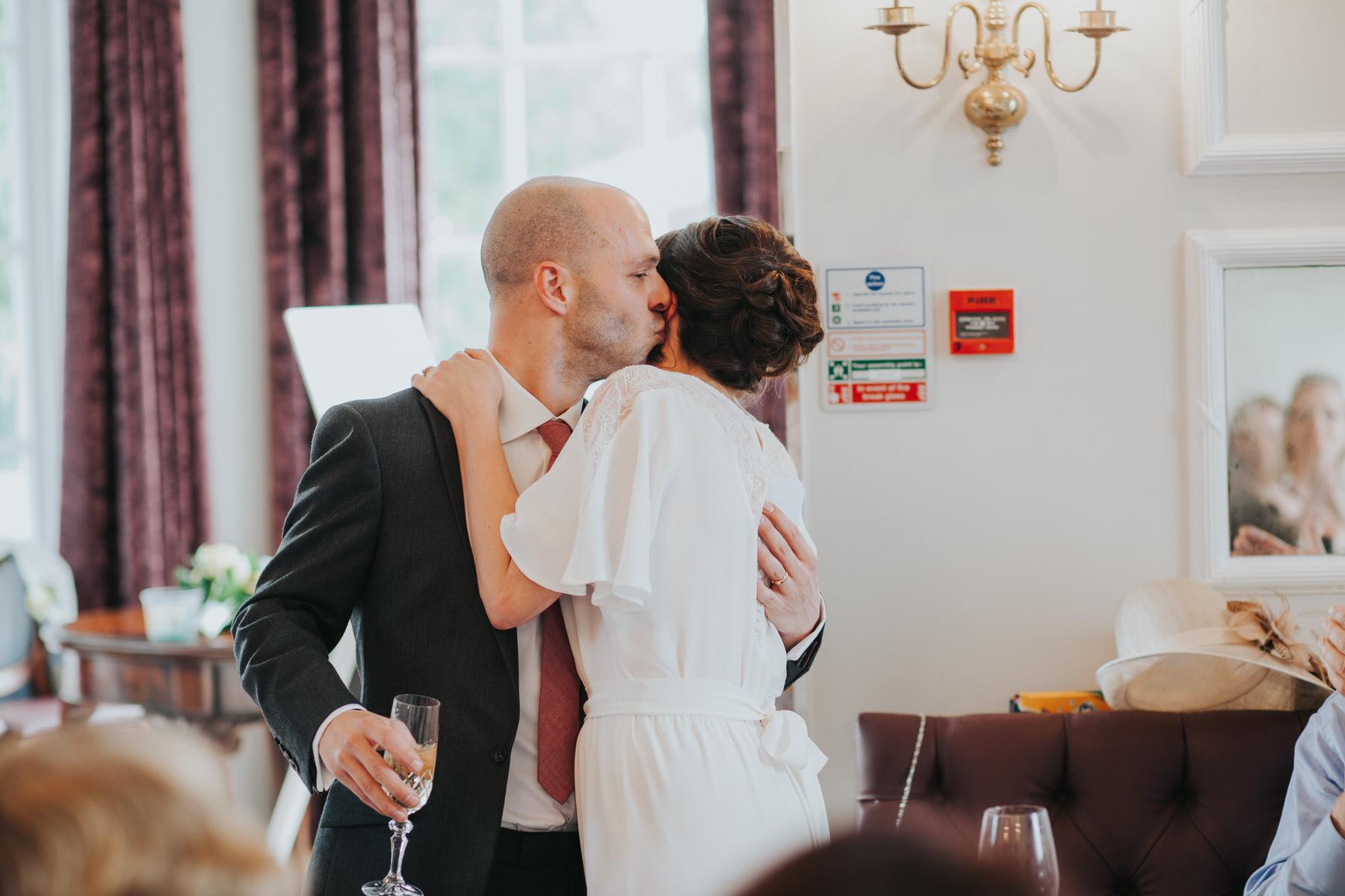 277 groom kissing bride Belair House wedding reception speeches.jpg