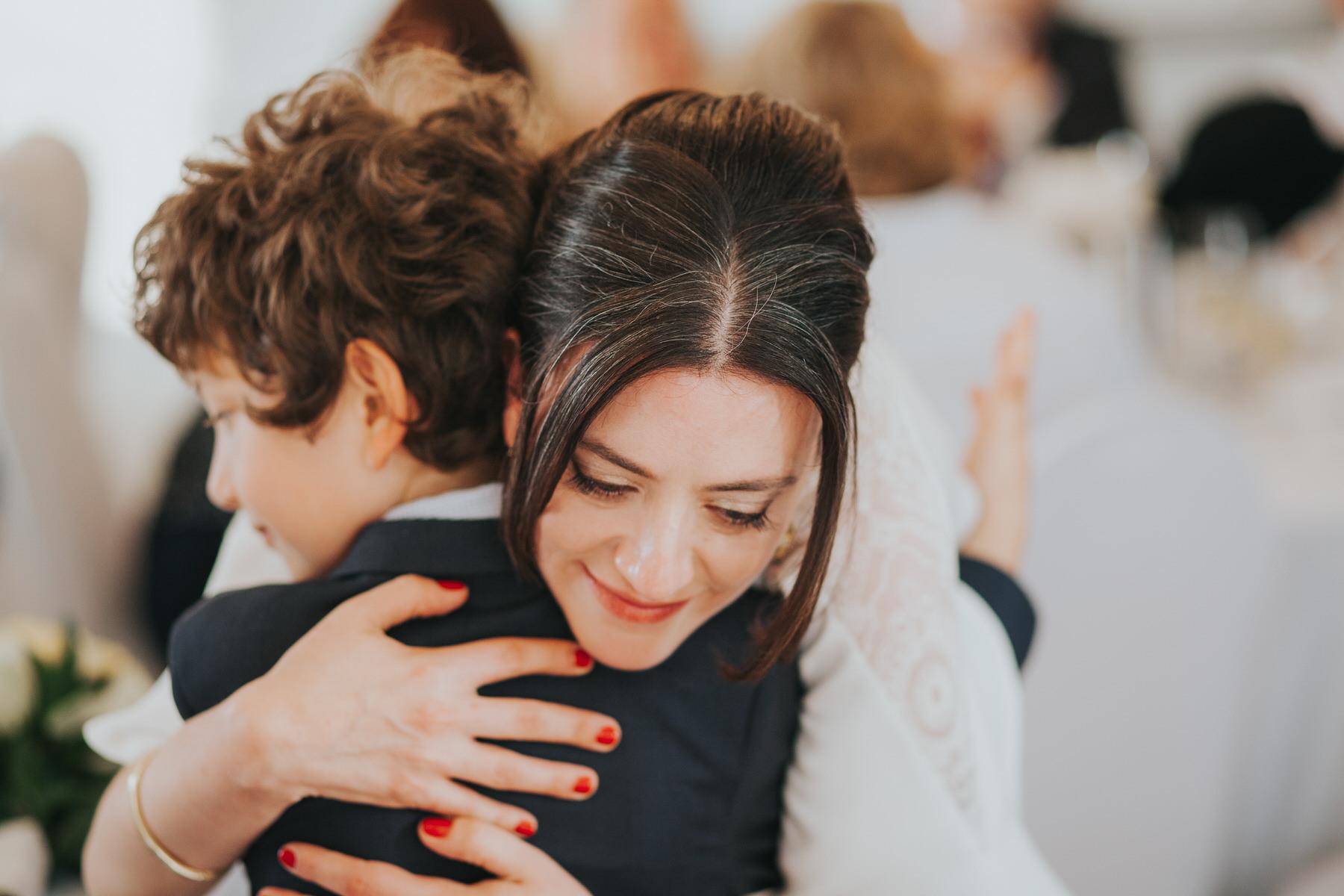 288-Belair House bride hugs boy.jpg