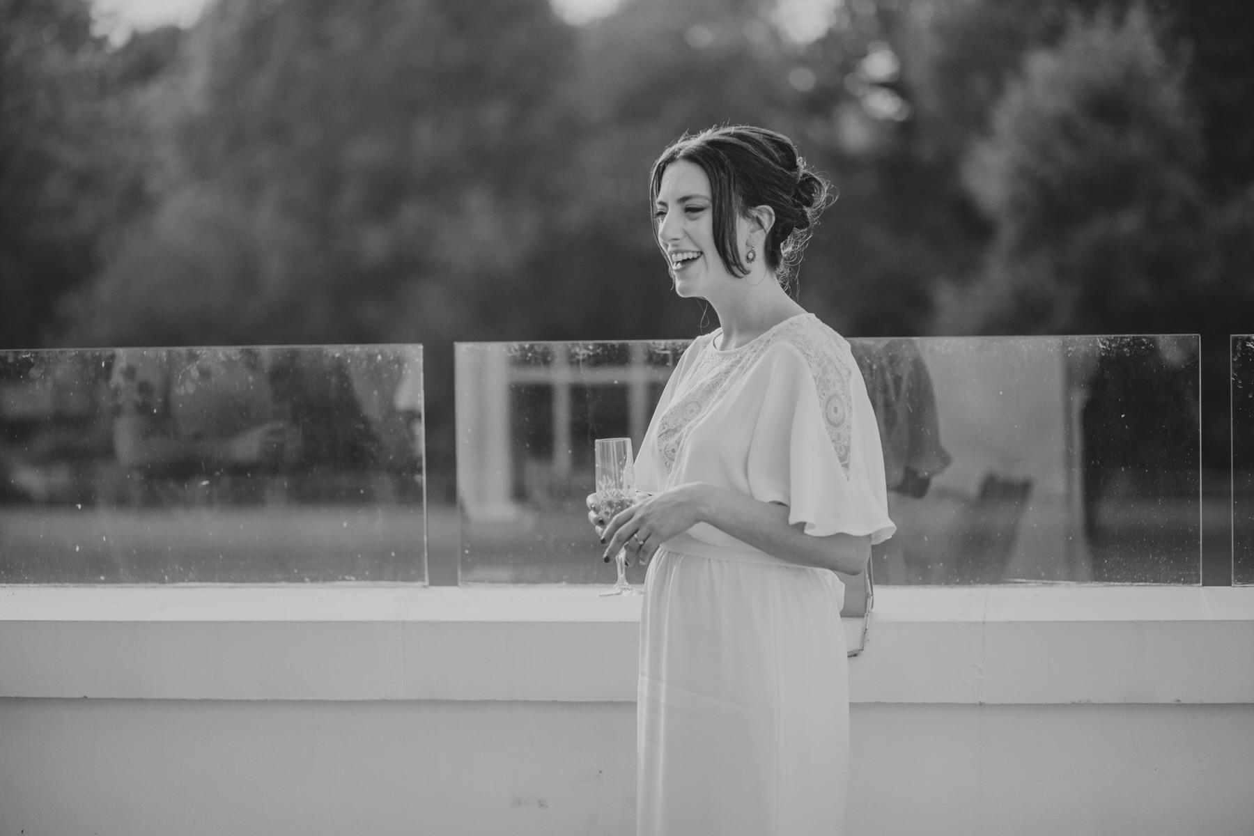 294-Belair House bride groom sunset drinks balcony.jpg