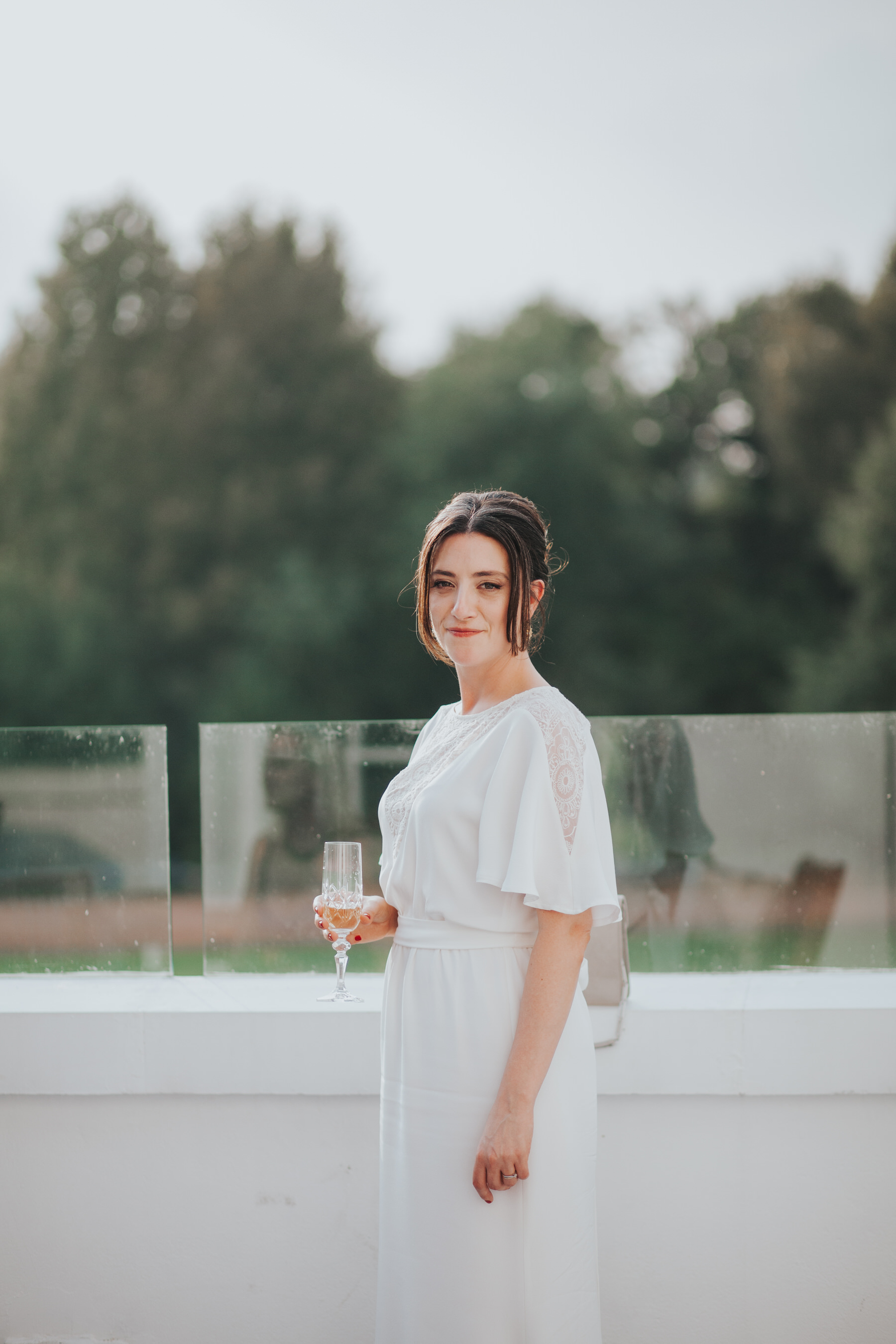 295-Belair House bride groom sunset drinks balcony.jpg
