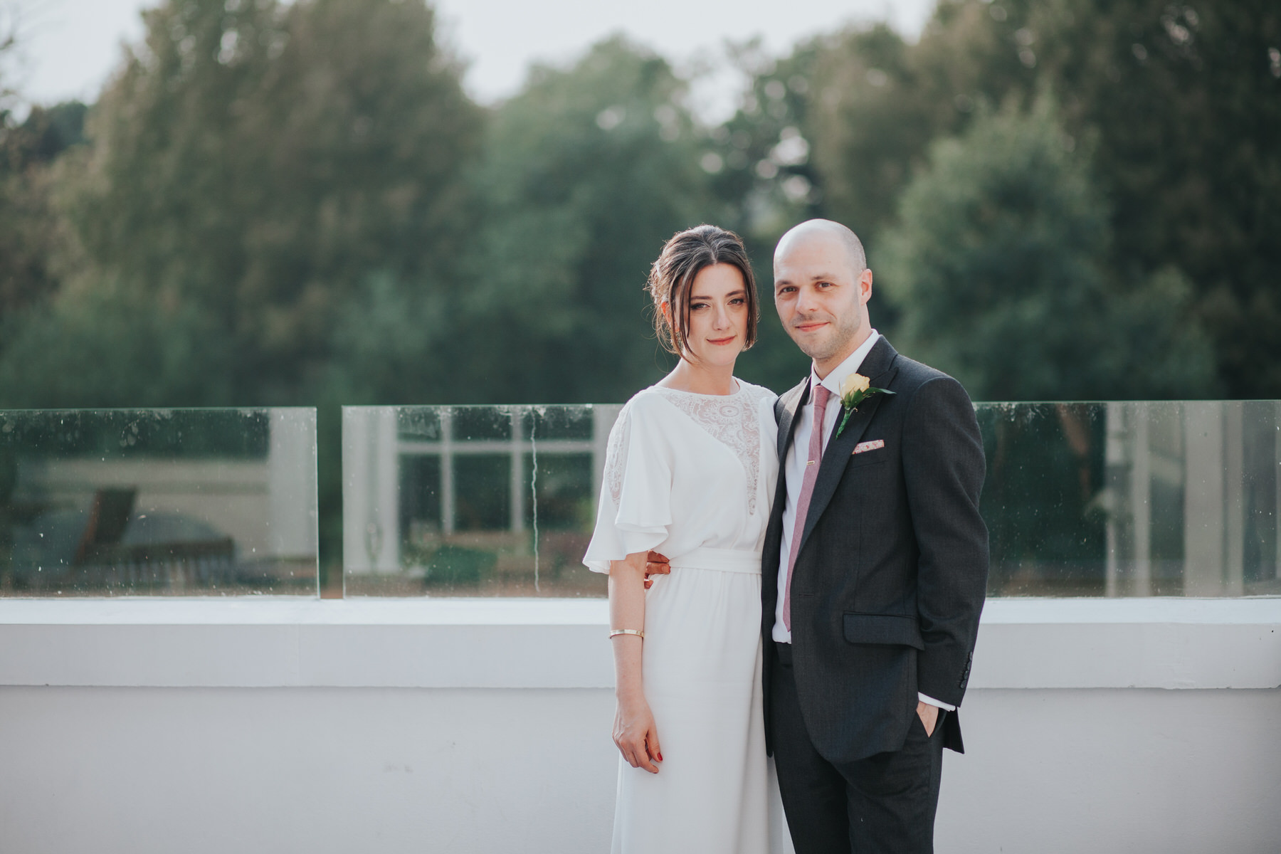 298-Belair House bride groom sunset drinks balcony.jpg