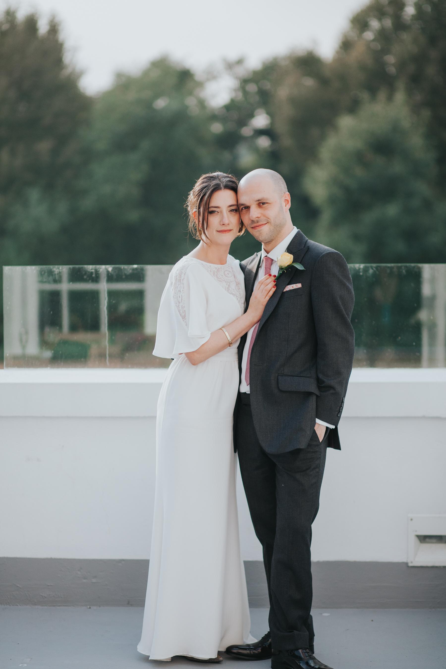 302-Belair House bride groom sunset drinks balcony.jpg