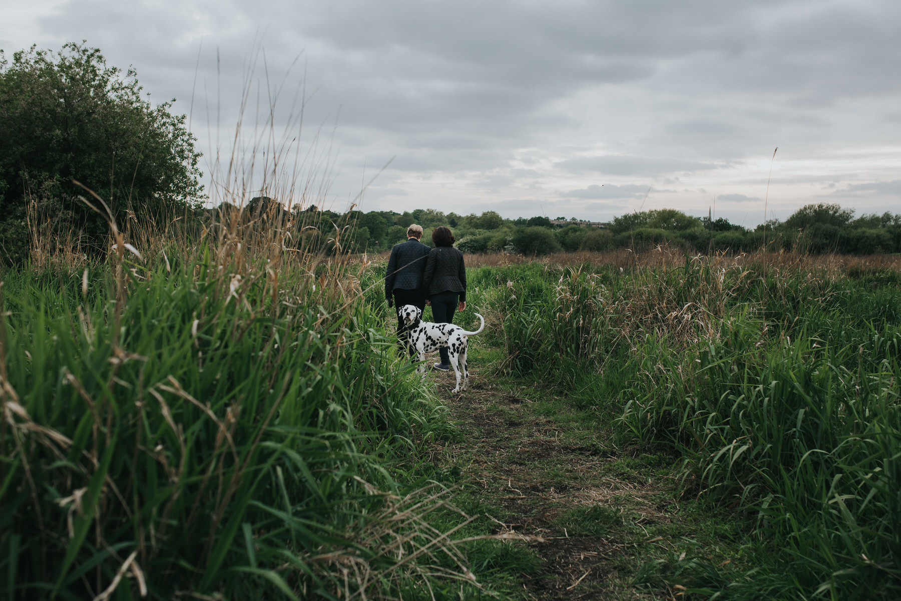 92 moody clouds Hackney marshes relaxed engagement shoot dalmatian dog.jpg