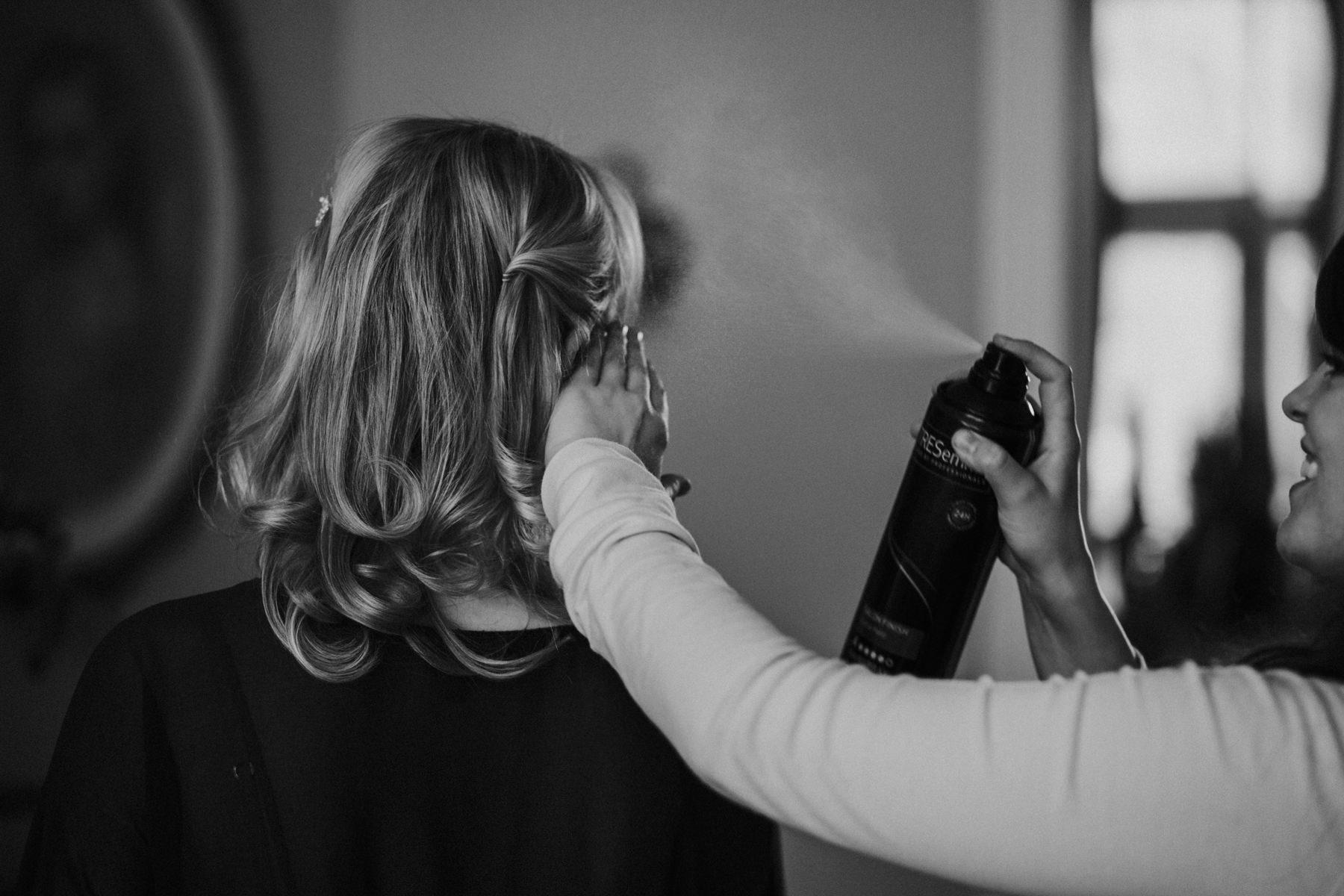bride hairsprayed BW repportage wedding photographer.jpg