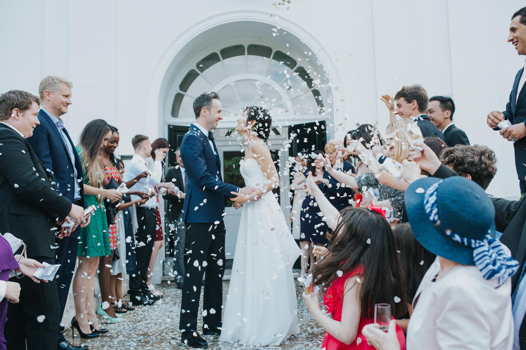 Belair House white confetti explosion reportage wedding.jpg