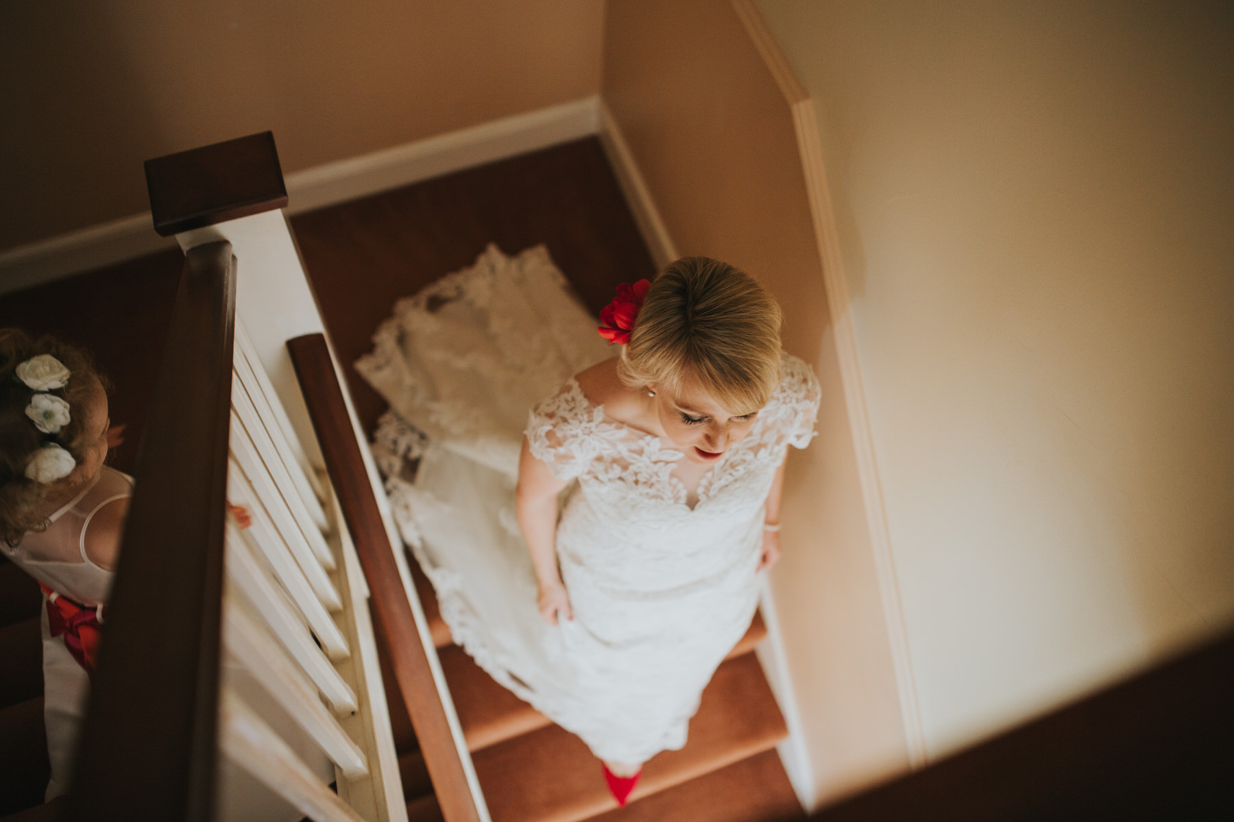 bride heading downstairs parents house Wapping wedding photographer.jpg