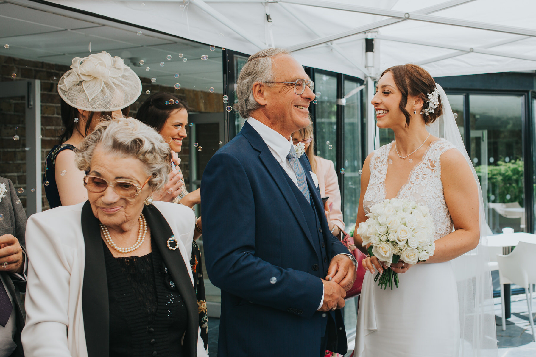 father happy bride grandma surrounded bubbles The Bingham Hotel wedding.jpg